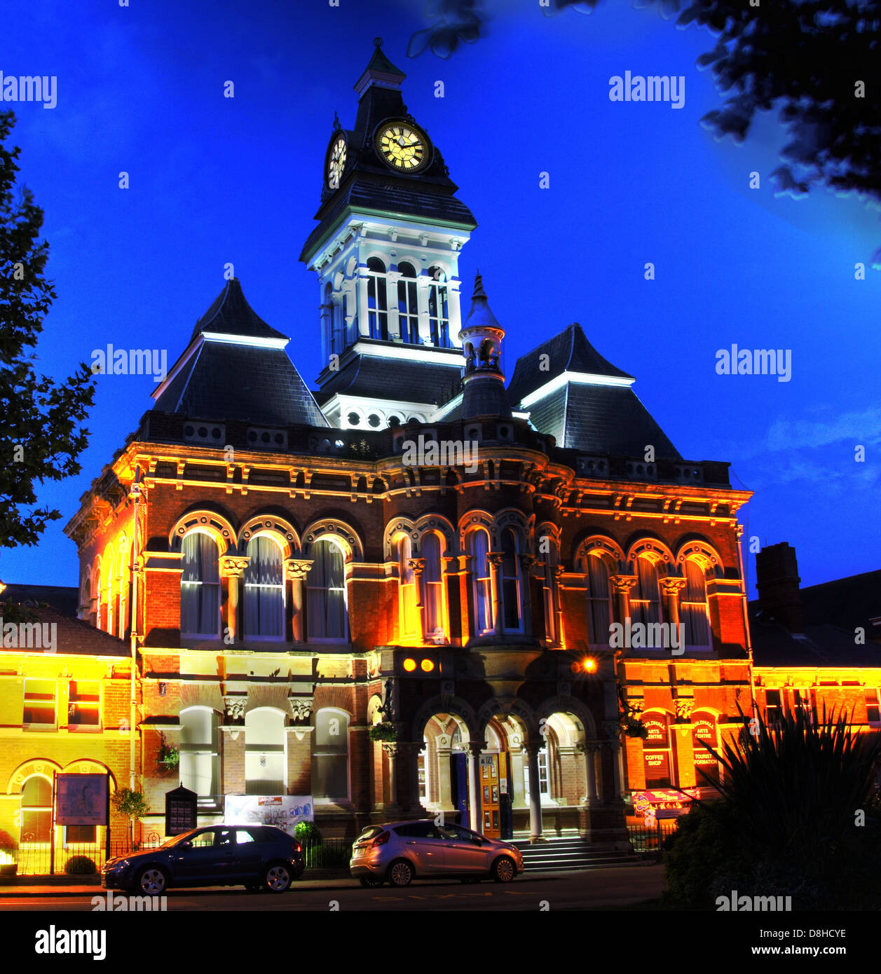 Grantham historic Guildhall , jail and four-sided clock at dusk, St Peter's Hill, Grantham NG31 6PZ - Stock Image