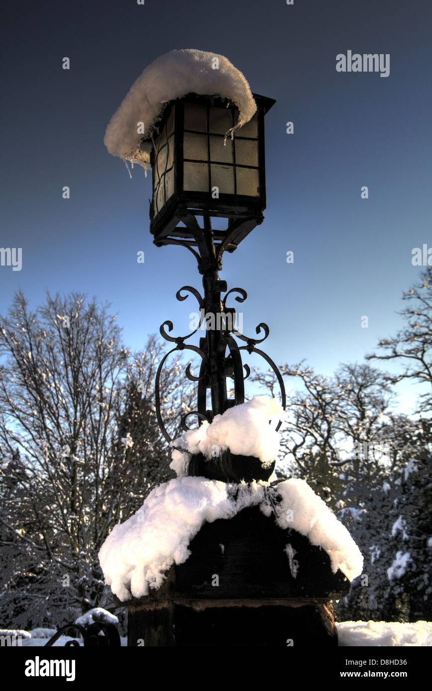 Snow on a churchgate lamp. Winter snowfall in Grappenhall Village, Warrington Cheshire, England, UK - Stock Image