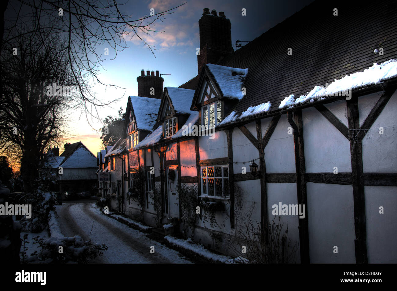 Great Budworth timber tudor thatched cottages In the snow, winter 2010, Northwich, Cheshire, England, UK. These Stock Photo