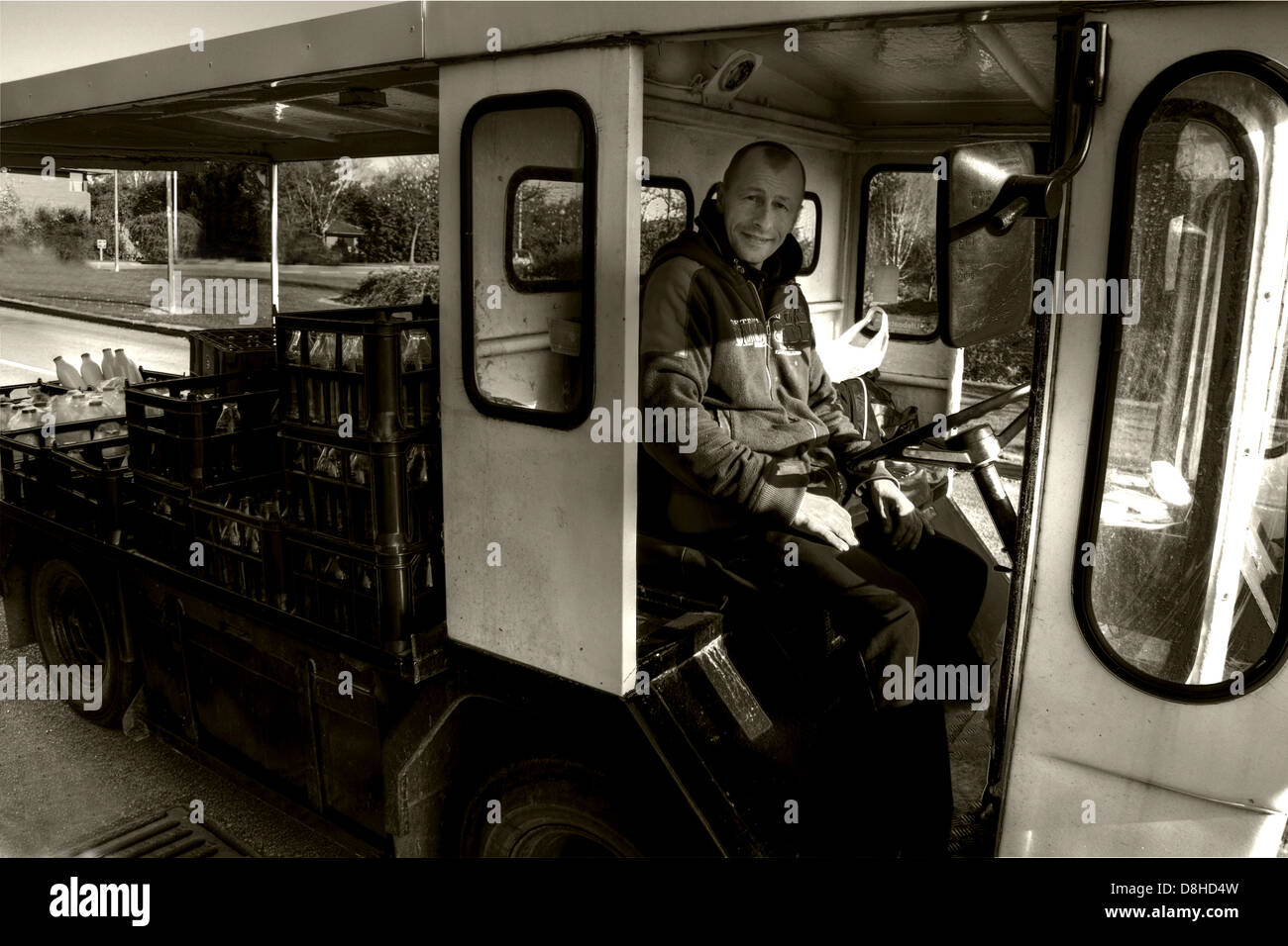 A traditional British electric milkfloat vehicle - Stock Image