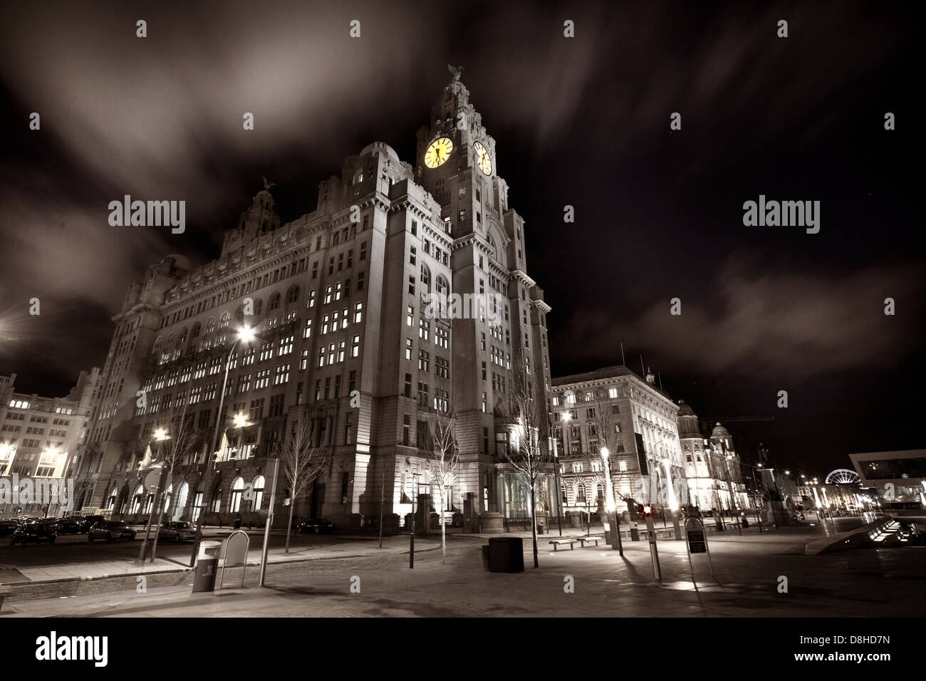 Dusk image of the Royal Liver Building on the Liverpool dock front at the Pier Head - Stock Image