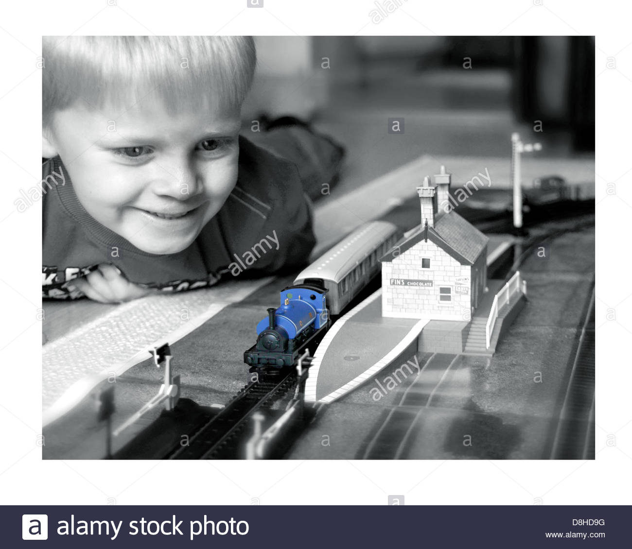 Young boy enjoying his Hornby 00 model railway and train set - Stock Image