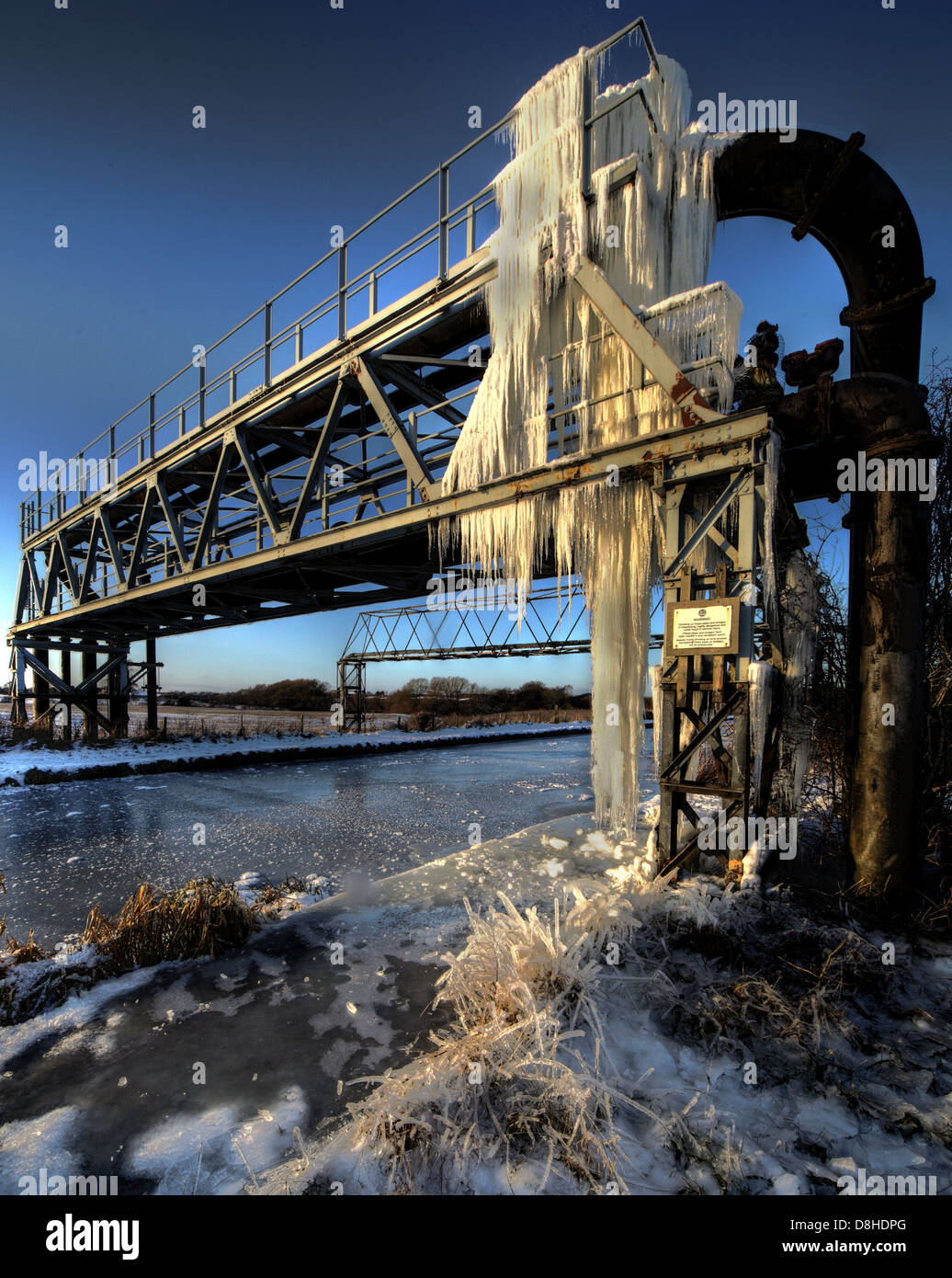 Extreme cold weather and icicles on pipework over the Trent And Mersey Canal, Rudheath, Northwich, Cheshire, England - Stock Image