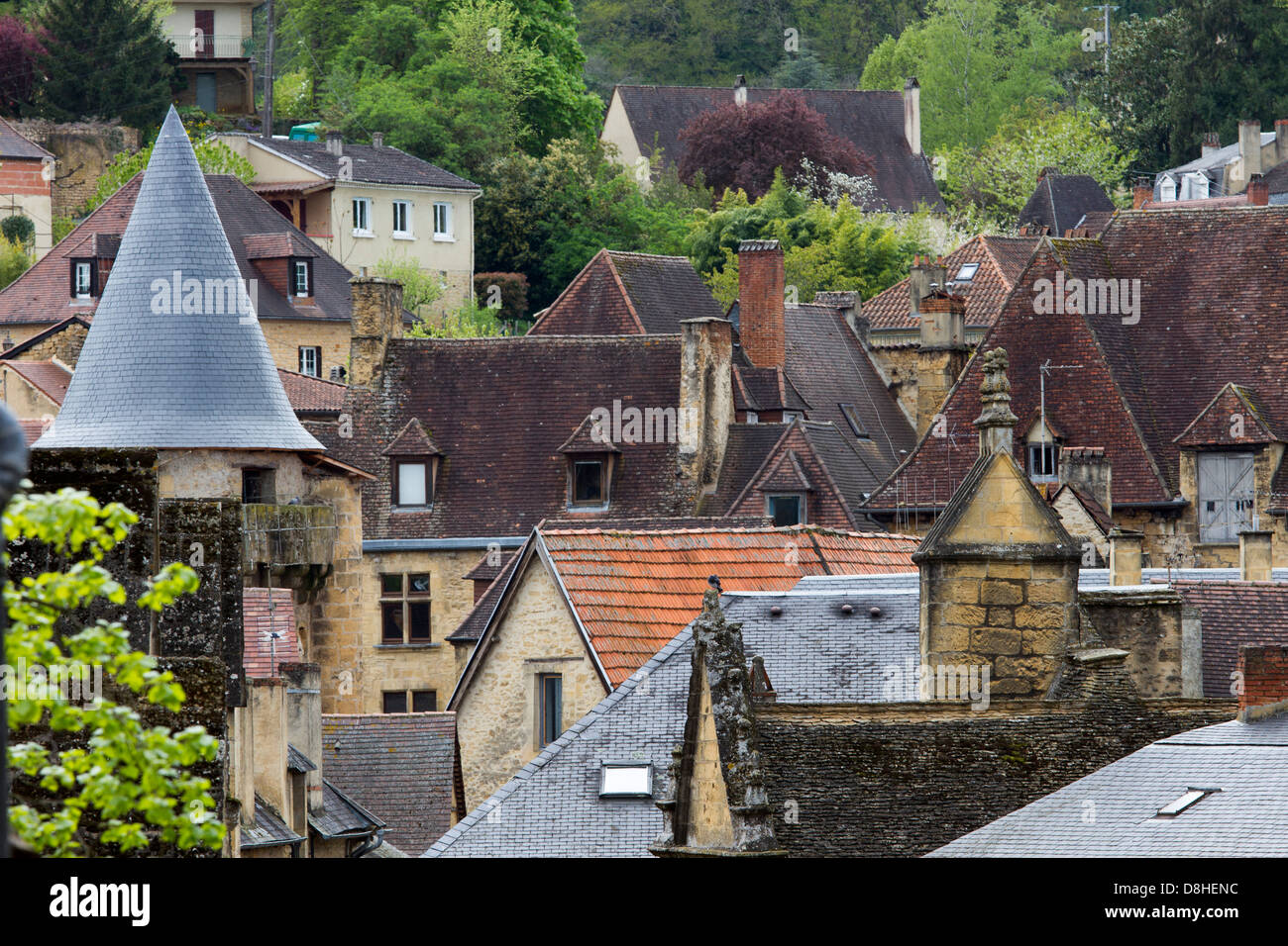Jumble of tile rooftops emerges from medieval sandstone houses in charming Sarlat, Dordogne region of France - Stock Image
