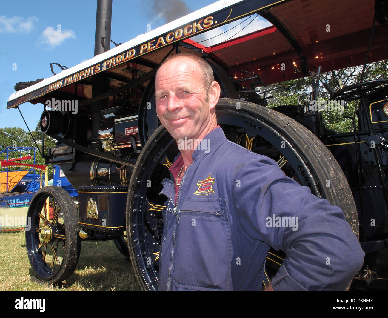 John Murphys Proud Peacocks Steam Engine at the Cheshire Steam Fair , July 2011 with engineer , Daresbury , Chester, Stock Photo