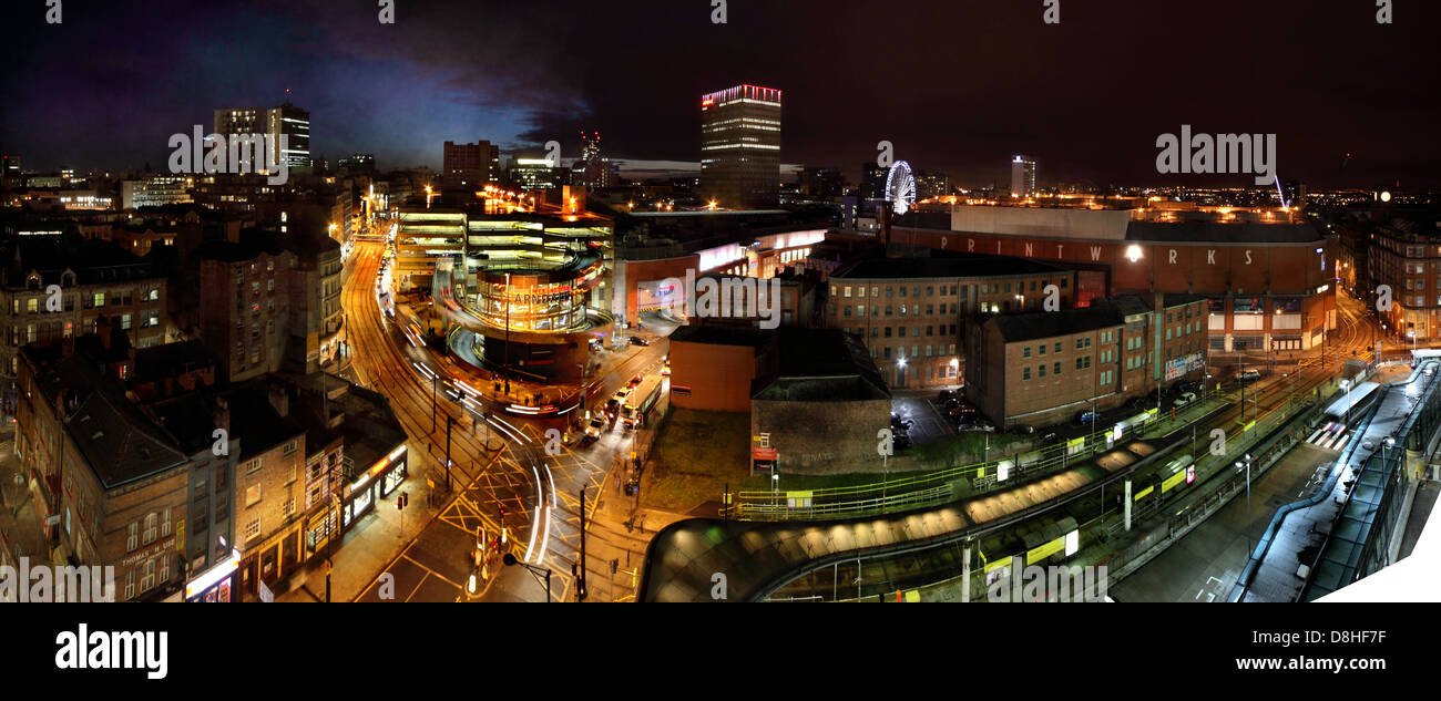Manchester , UK dusk night panorama looking from Shude Hill towards market street and Piccadilly Gardens - Stock Image