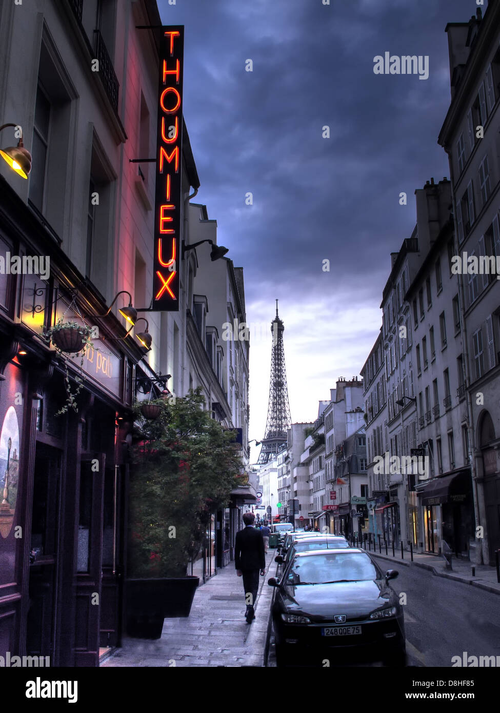 A single frenchman walks from 79 Rue Saint-Dominique  75007 Paris, France , The Thoumieux restaurant. - Stock Image