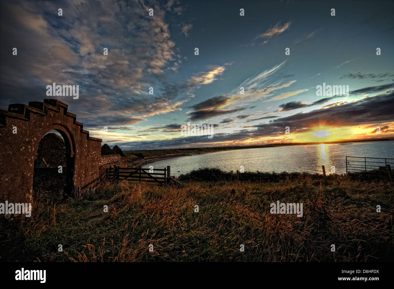 Sunset at the Ruins of St Columbas Church, Aignish, outside Stornoway Isle Of Lewis, Scotland - Stock Image