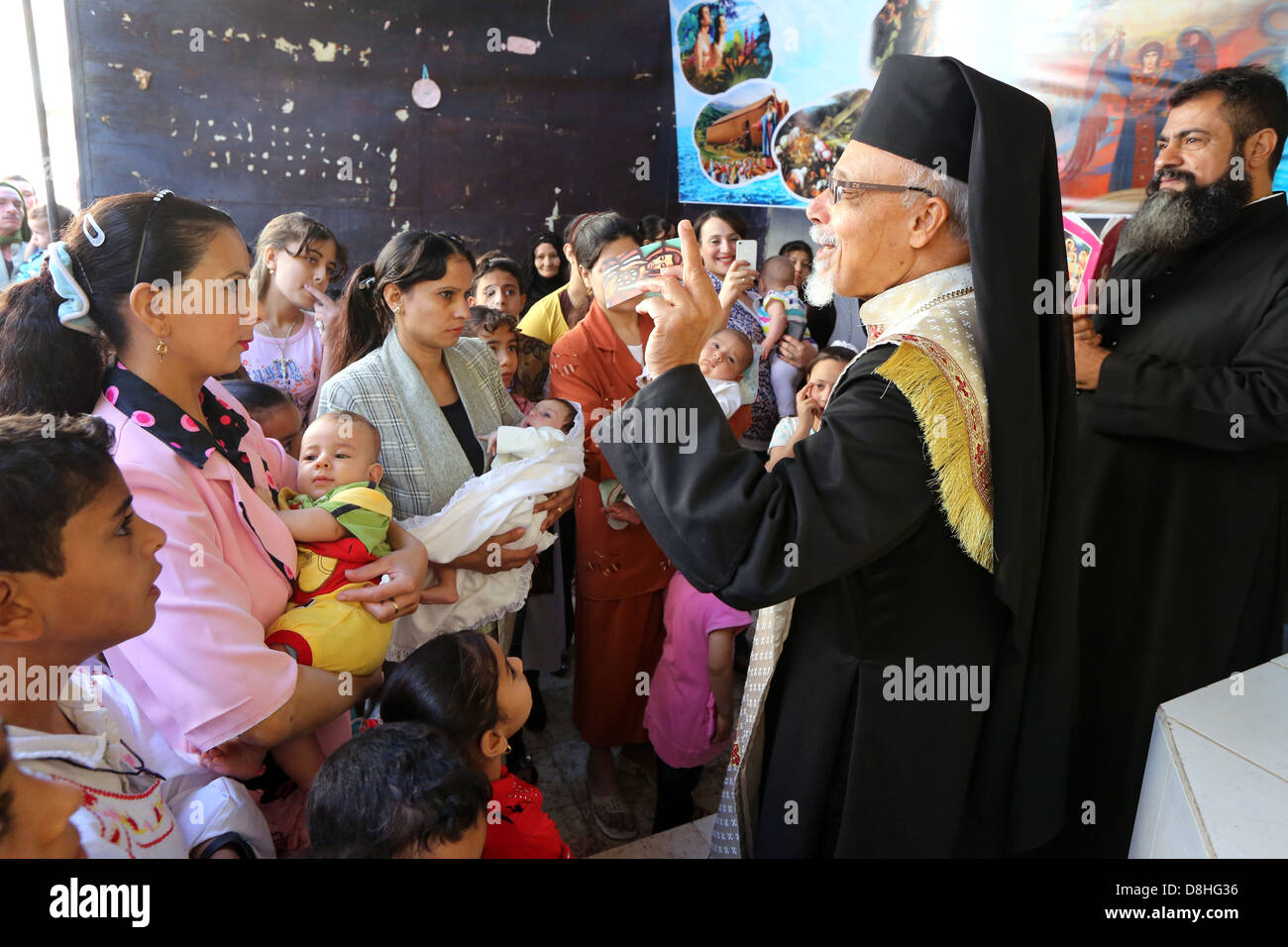 baptism ceremony of babies by catholic coptic bishop KYRILLOS WILLIAM of Asyut diocese, Egypt - Stock Image