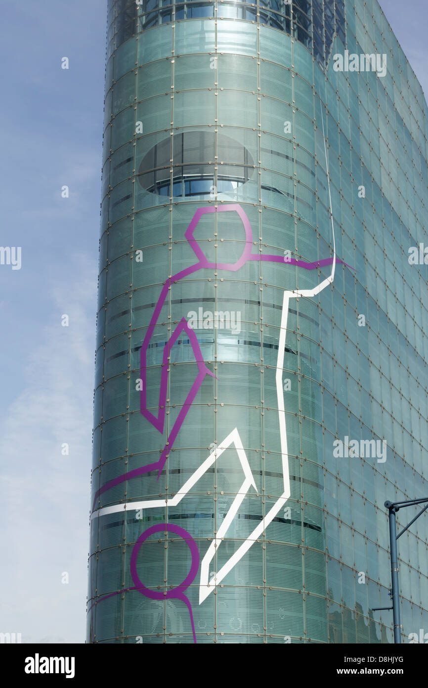 An outline footballer figure on the front edge of the National Football Museum now sited in the Urbis building in - Stock Image