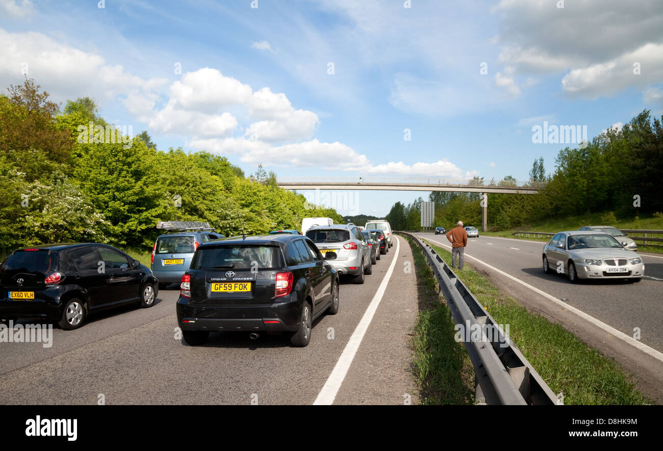 People on the road during a traffic jam due to an accident on the A20 dual carriageway road, Kent UK Stock Photo