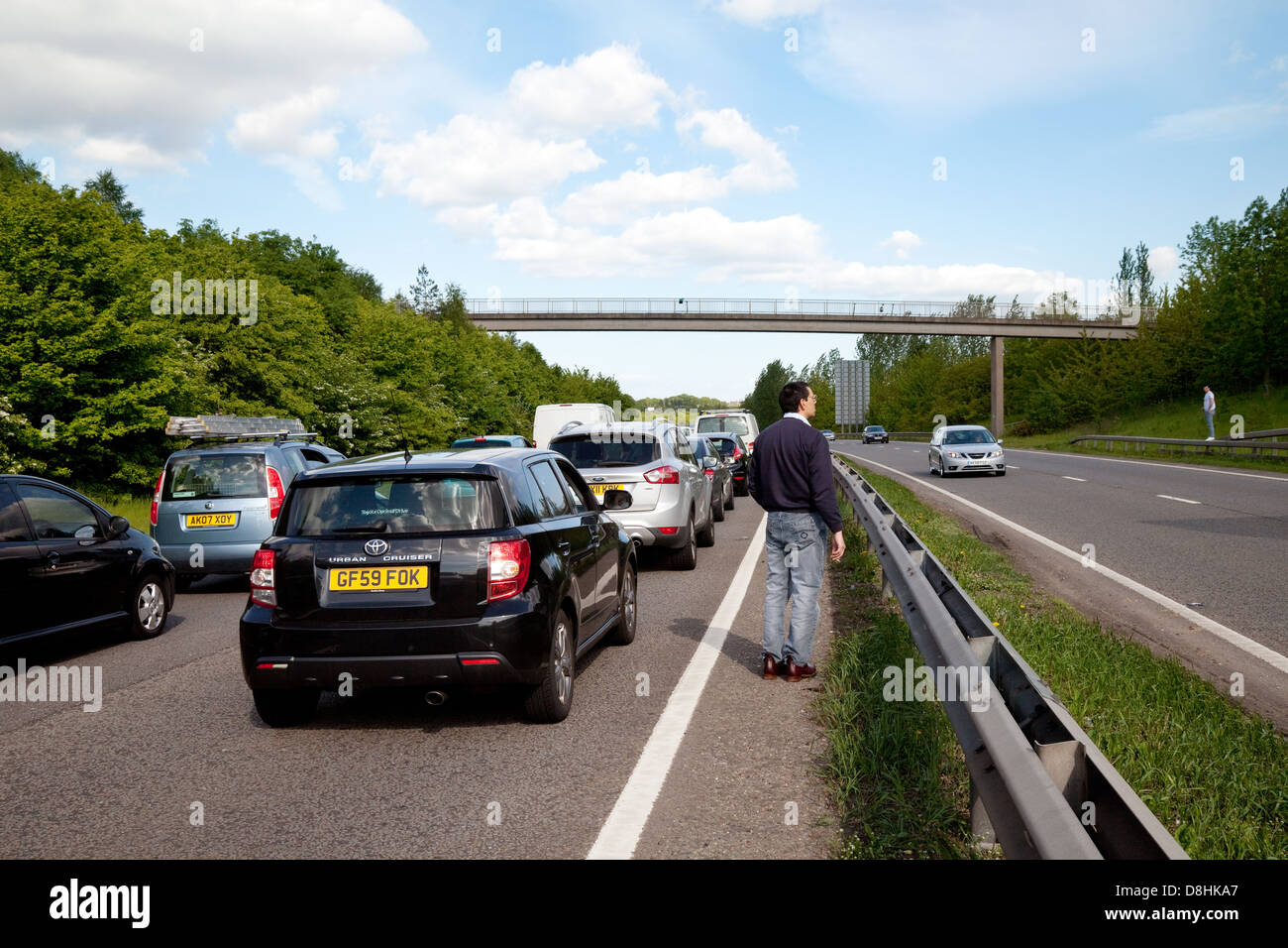 People on the road during a traffic jam due to an accident on the A20 dual carriageway road, Kent UK - Stock Image