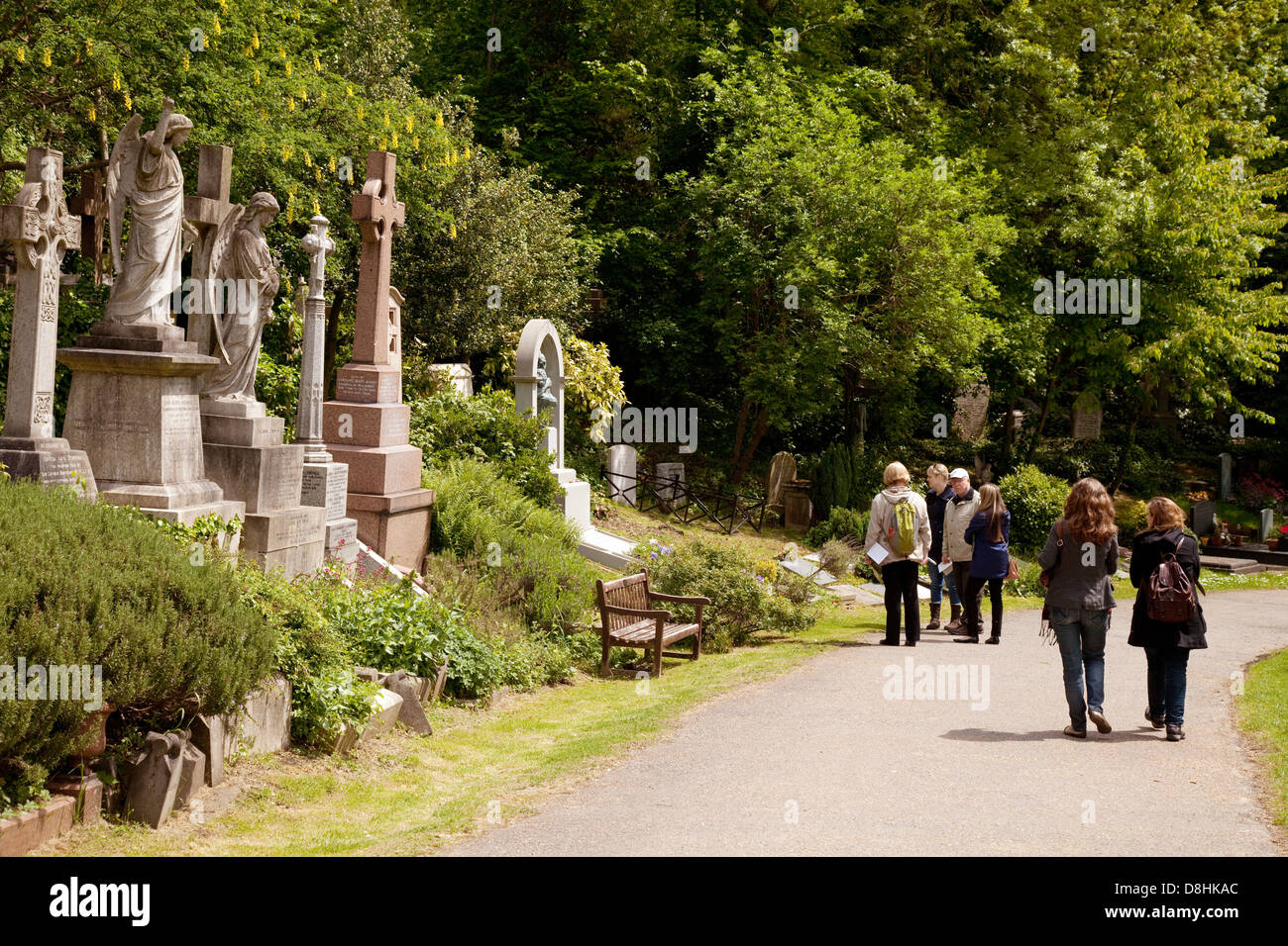 Visitors looking at the famous graves in Highgate cemetery East, London UK - Stock Image