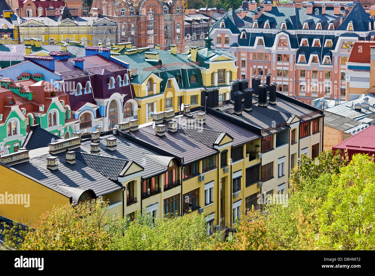 Elevated view over colourful buildings with multicolor roofs in a new residential area of Kiev, Ukraine, Eastern - Stock Image