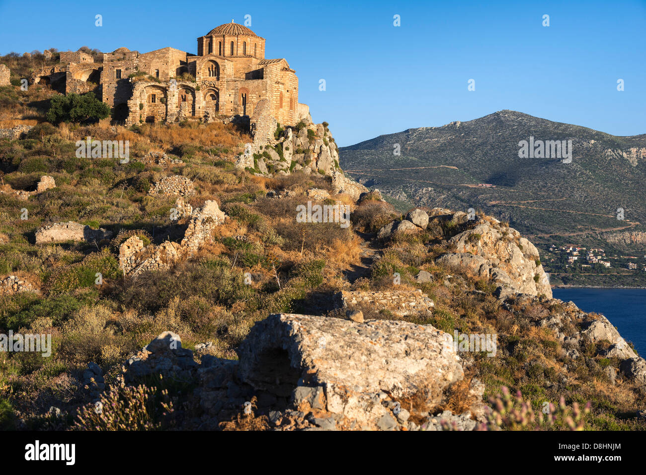Agia Sofia church and the ruined citadel above the old Byzantine town of Monemvasia, in Lakonia, Southern Peloponnese, Stock Photo