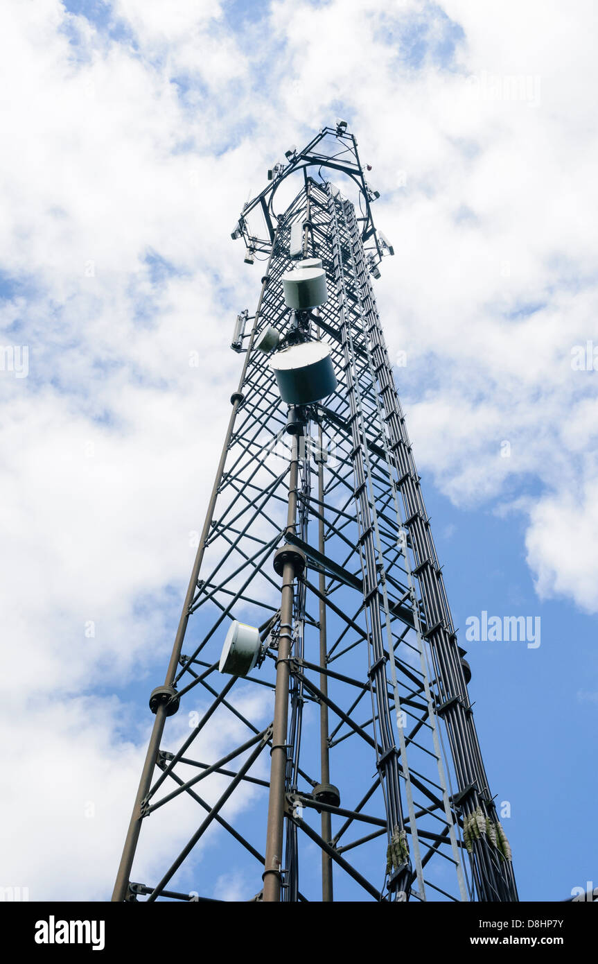 Mobile (cell) phone radio transmission tower with microwave dishes and cellular antannae - Stock Image