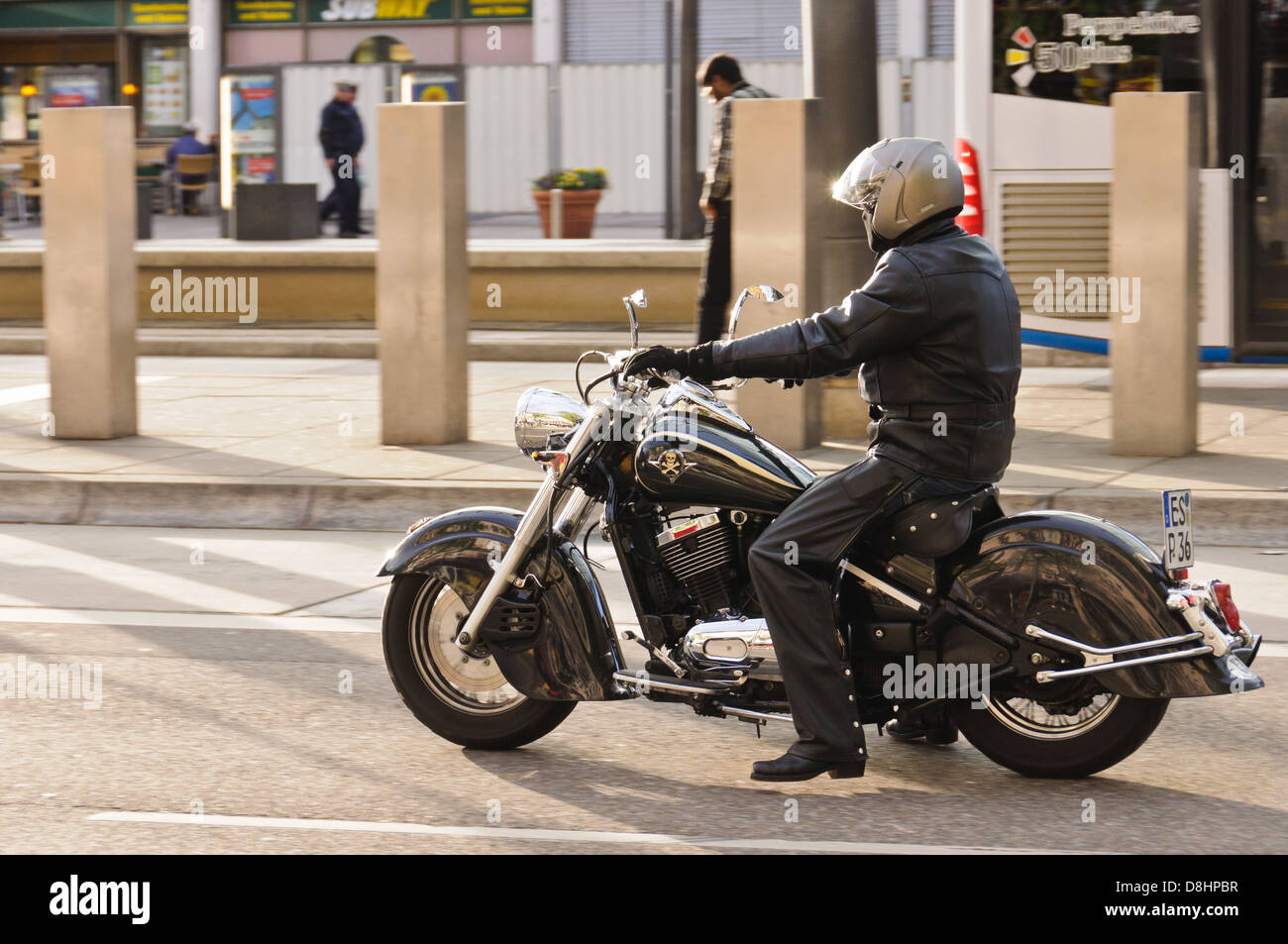 Biker in black motorcycle clothing and gray helmet, riding a heavy black Kawasaki Drifter motorbike – Heilbronn - Stock Image