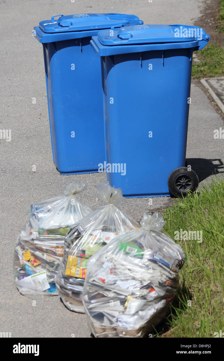 Garbage cans and bags - Stock Image