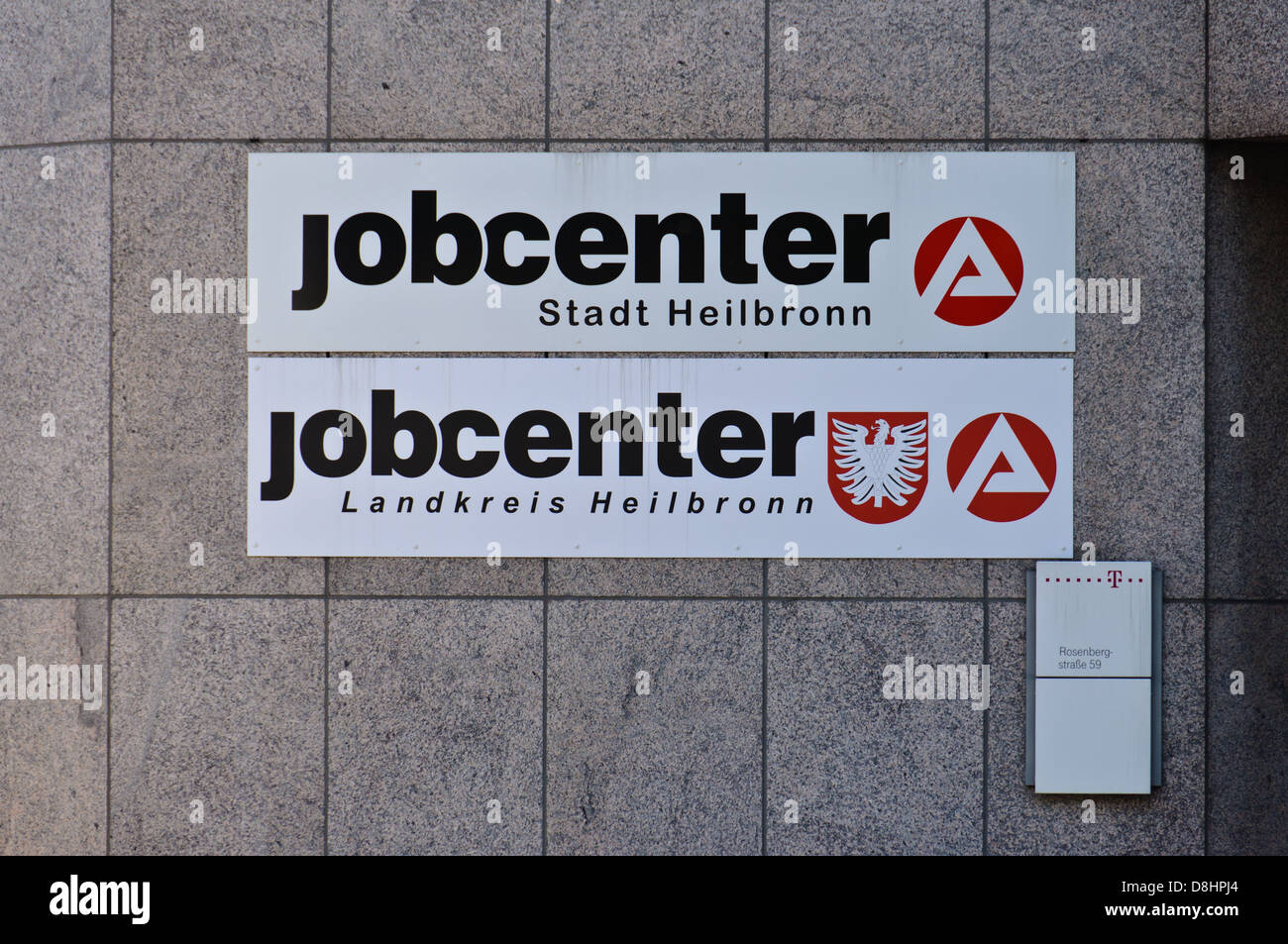 Jobcenter, German employment agency, and Deutsche Telecom signs and logo – Heilbronn Germany - Stock Image