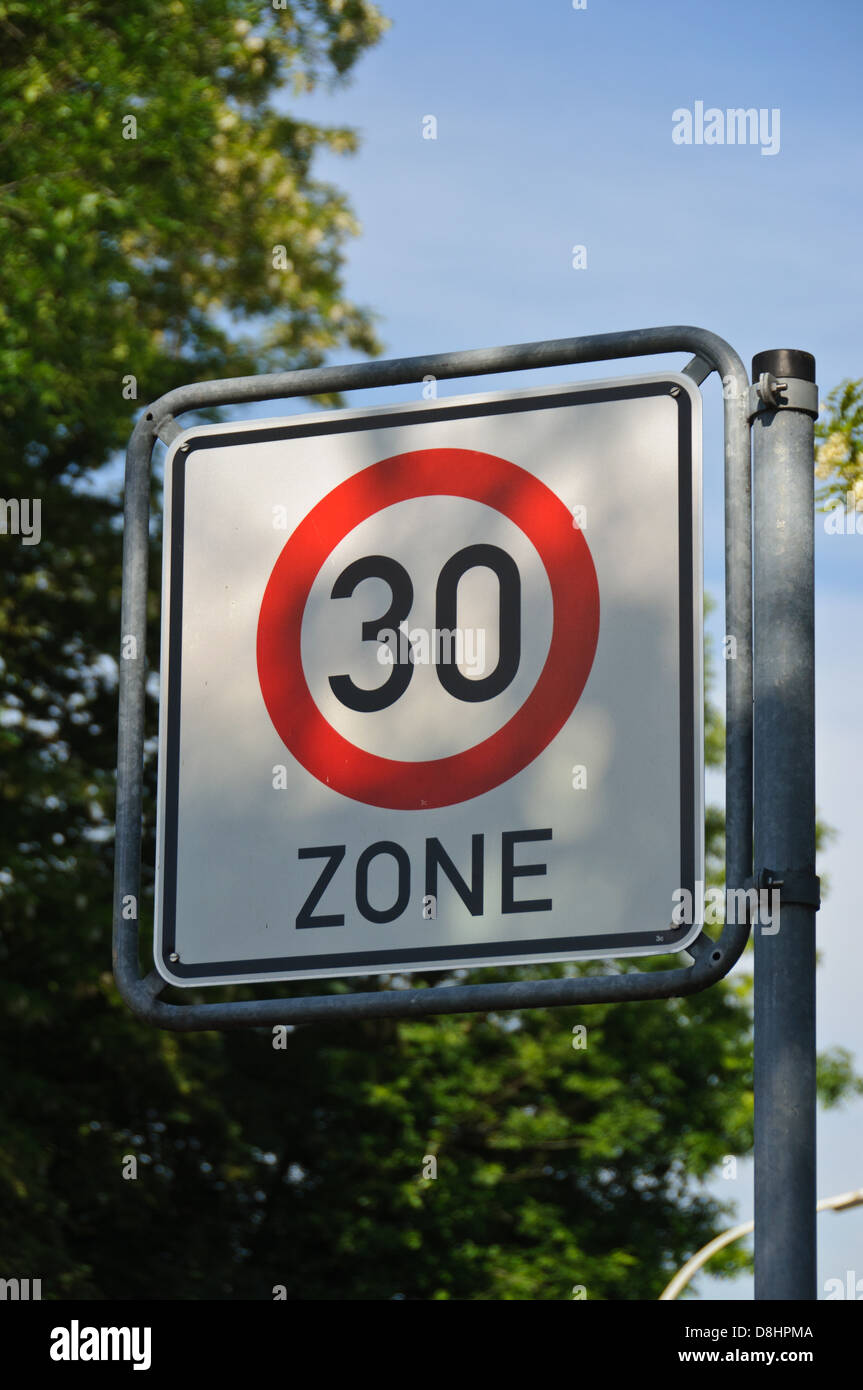 """German traffic sign """"Zone 30"""", indicating a speed limit of 30 km/h (kilometers per hour) – Heilbronn, Germany Stock Photo"""