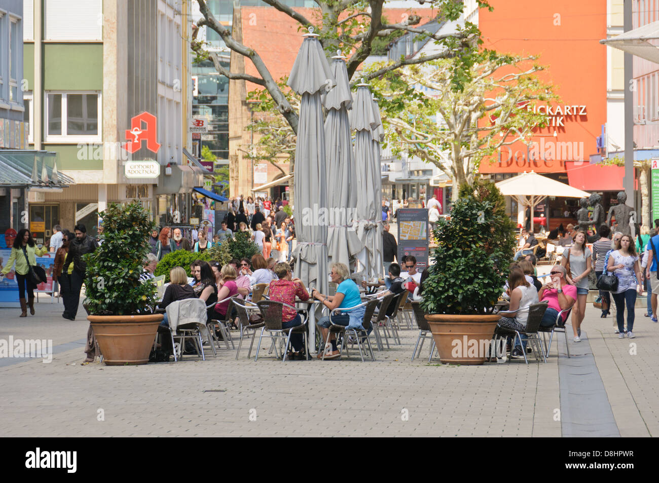 Summer in the city – people sitting in a street cafe, persons window shopping in a downtown pedestrian zone, Heilbronn - Stock Image