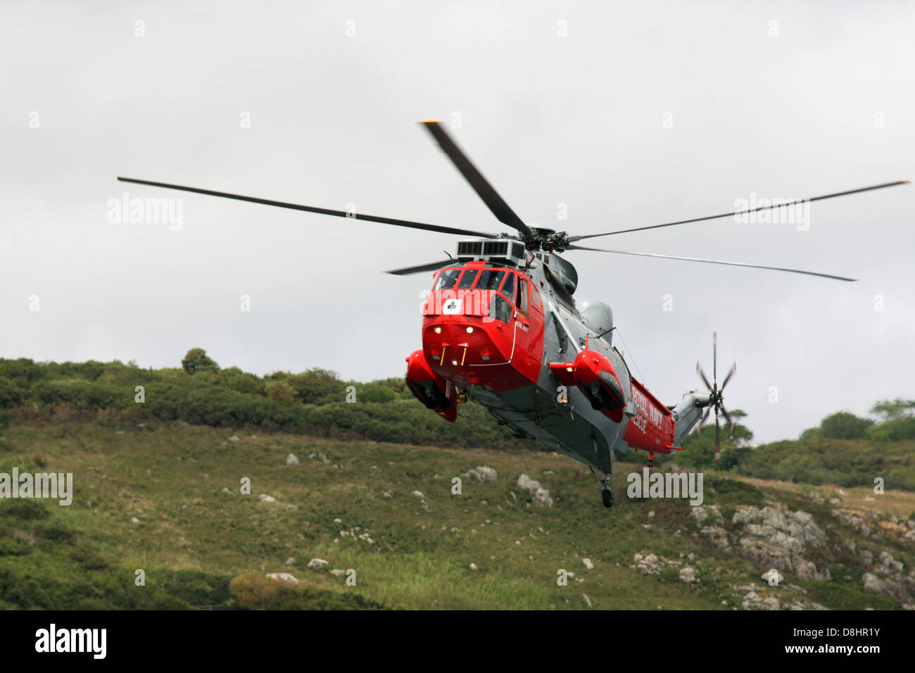 Sea King Helicopter performs a rescue demonstration - Stock Image