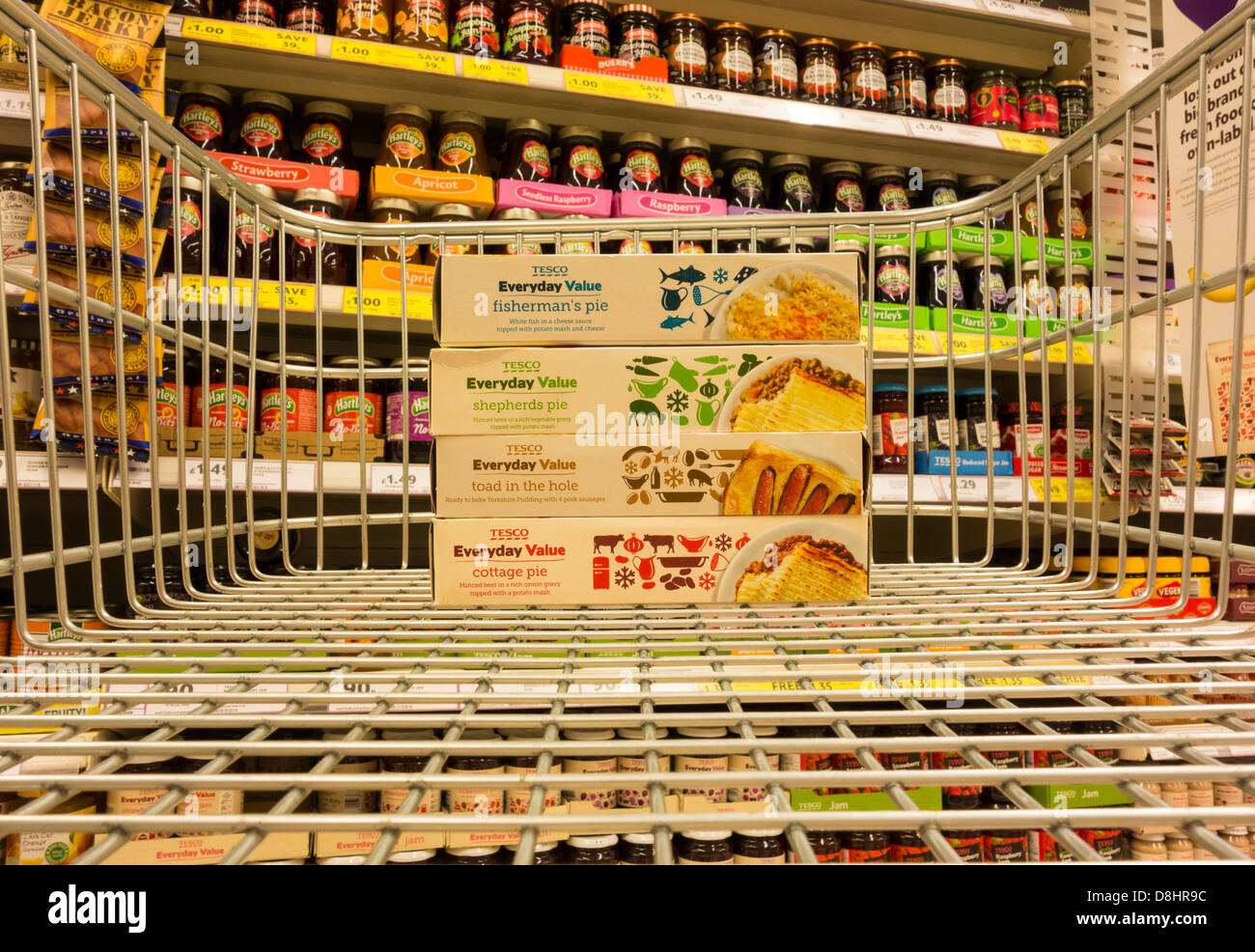 Tesco's Everyday Value own label products in shopping trolley in Tesco supermarket. England, UK - Stock Image