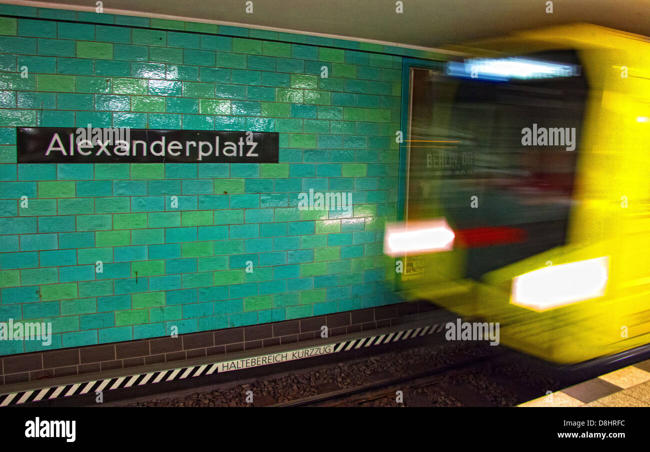 Metro train arrives at Berlin Alexanderplatz UBahn Station - Stock Image