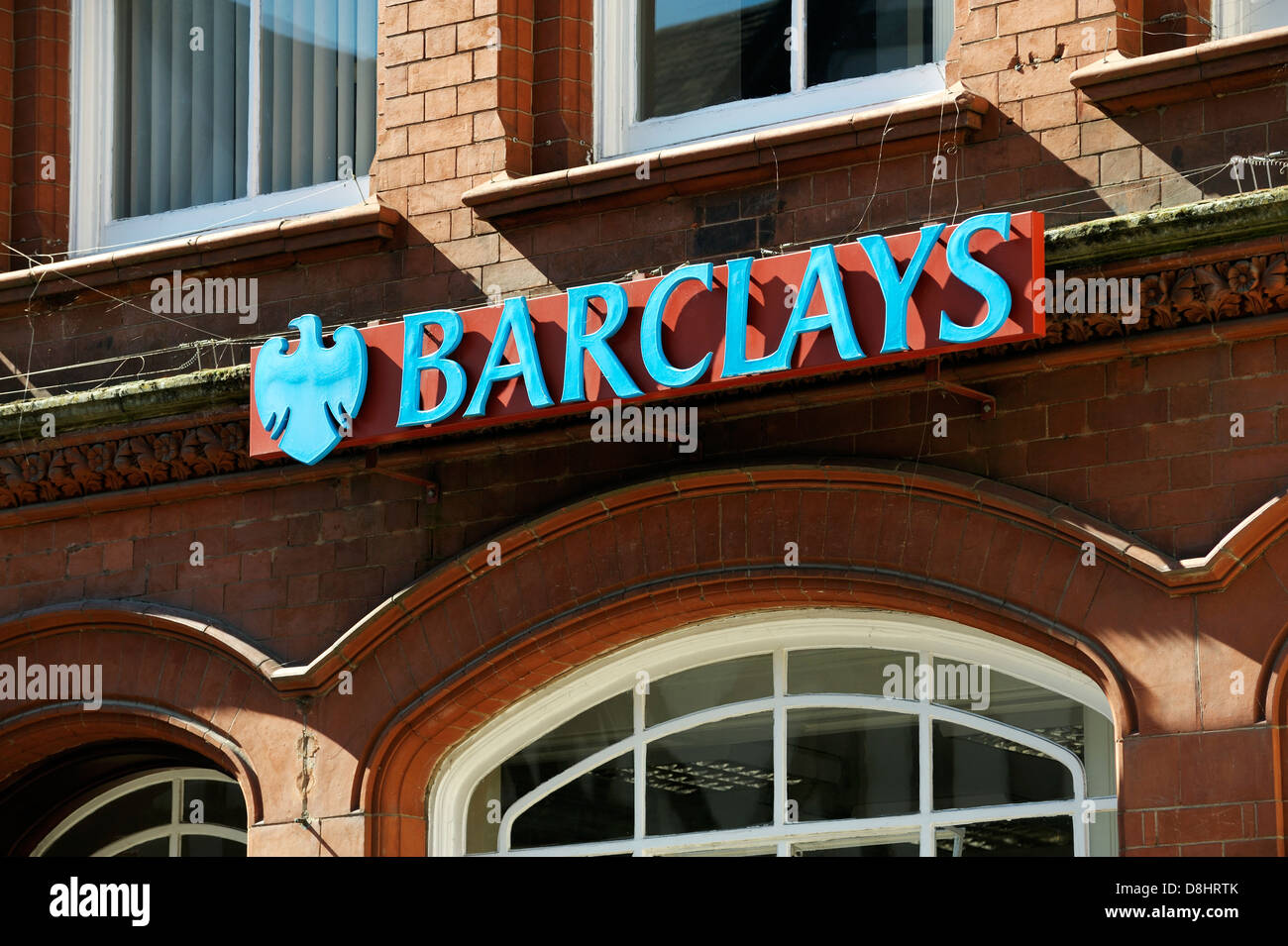 Barclays logo high street bank sign outside branch of Barclays bank in the Shropshire town of Ludlow, England - Stock Image
