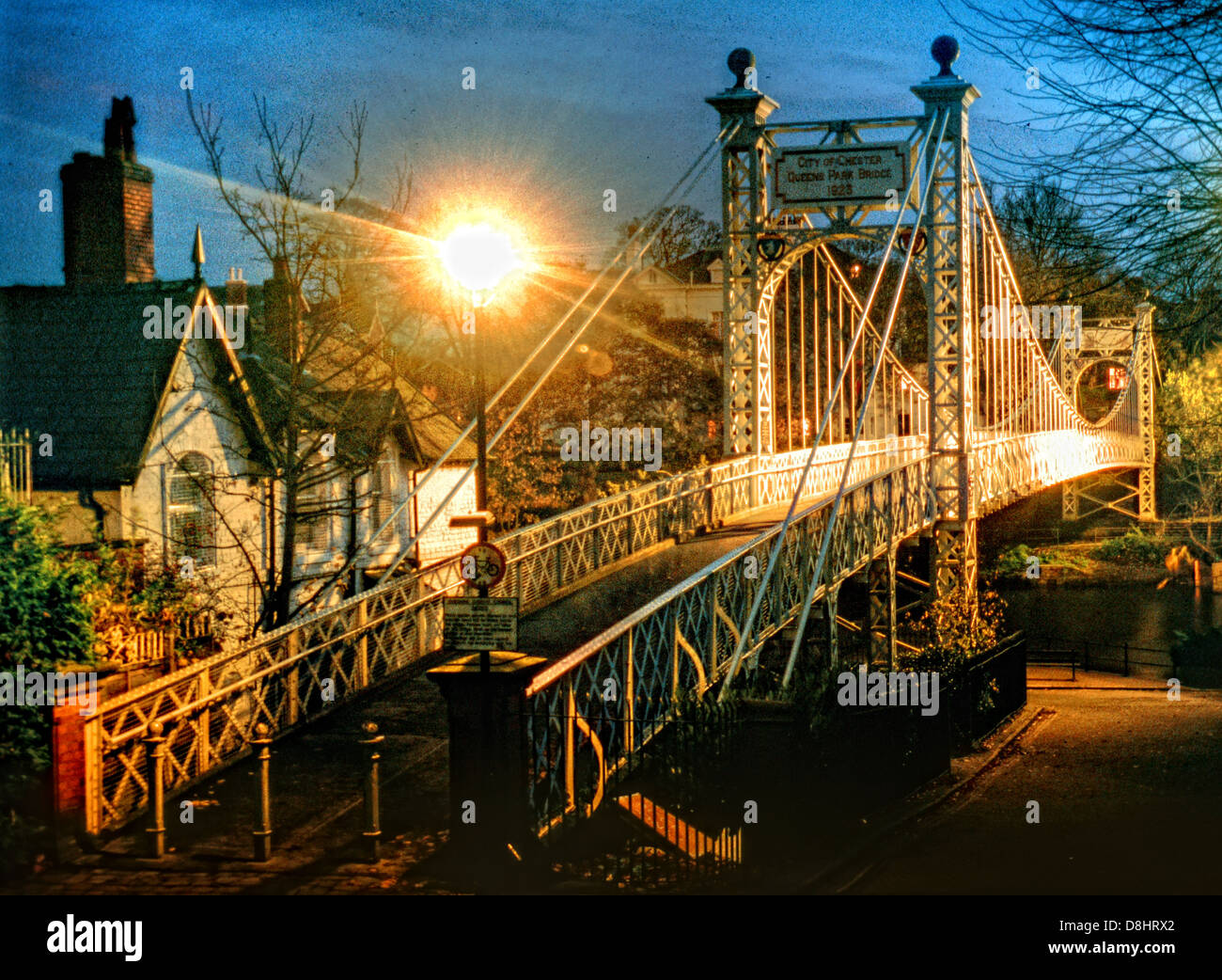 Suspension Queens Park footbridge river Dee Chester City at dusk, North West England, UK - Stock Image
