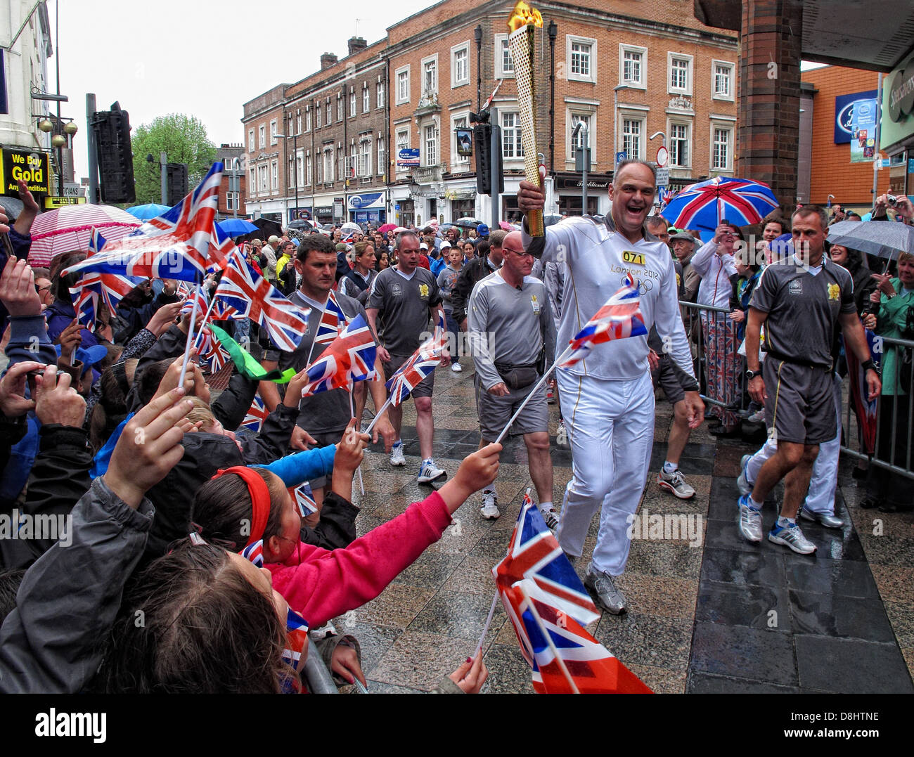 Runner 071 Brings the olympic flame into Warrington up Sankey St, near Golden Square shopping area Stock Photo