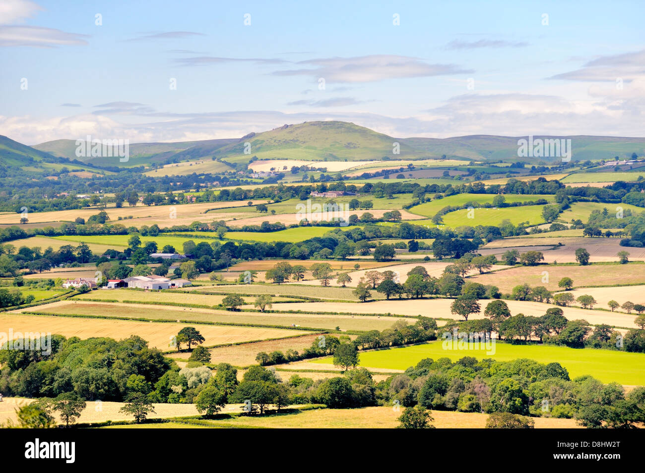 Southwest from Wenlock Edge near Easthope over summer farmland of Ape Dale to Caer Caradoc and The Long Mynd, Shropshire - Stock Image