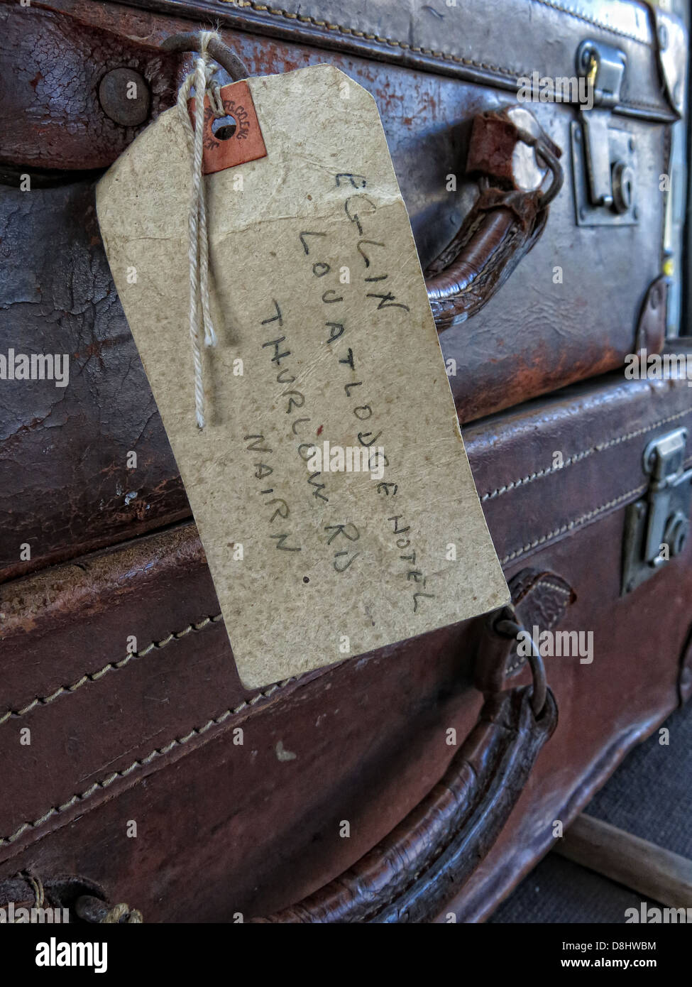Old suitcases on a GWR English railway platform - Stock Image