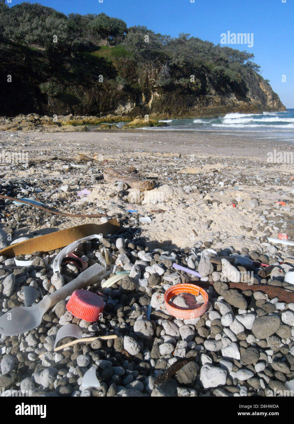 Plastic rubbish washed up amongst the pumice, South Gorge beach, North Stradbroke Island, Queensland, Australia - Stock Image