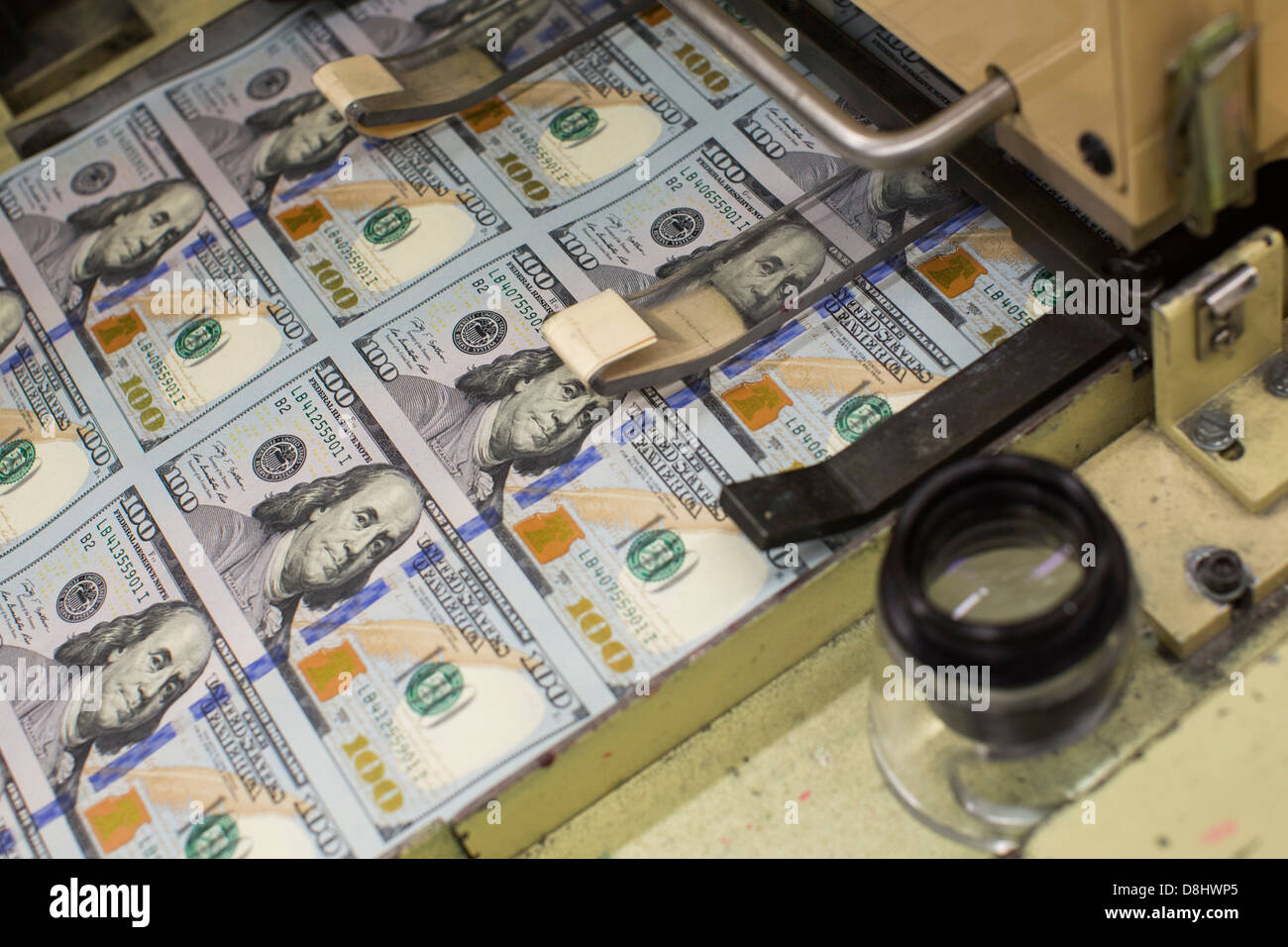 The newly redesigned $100 bill being printed at the Bureau of Engraving and Printing in Washington, DC. - Stock Image