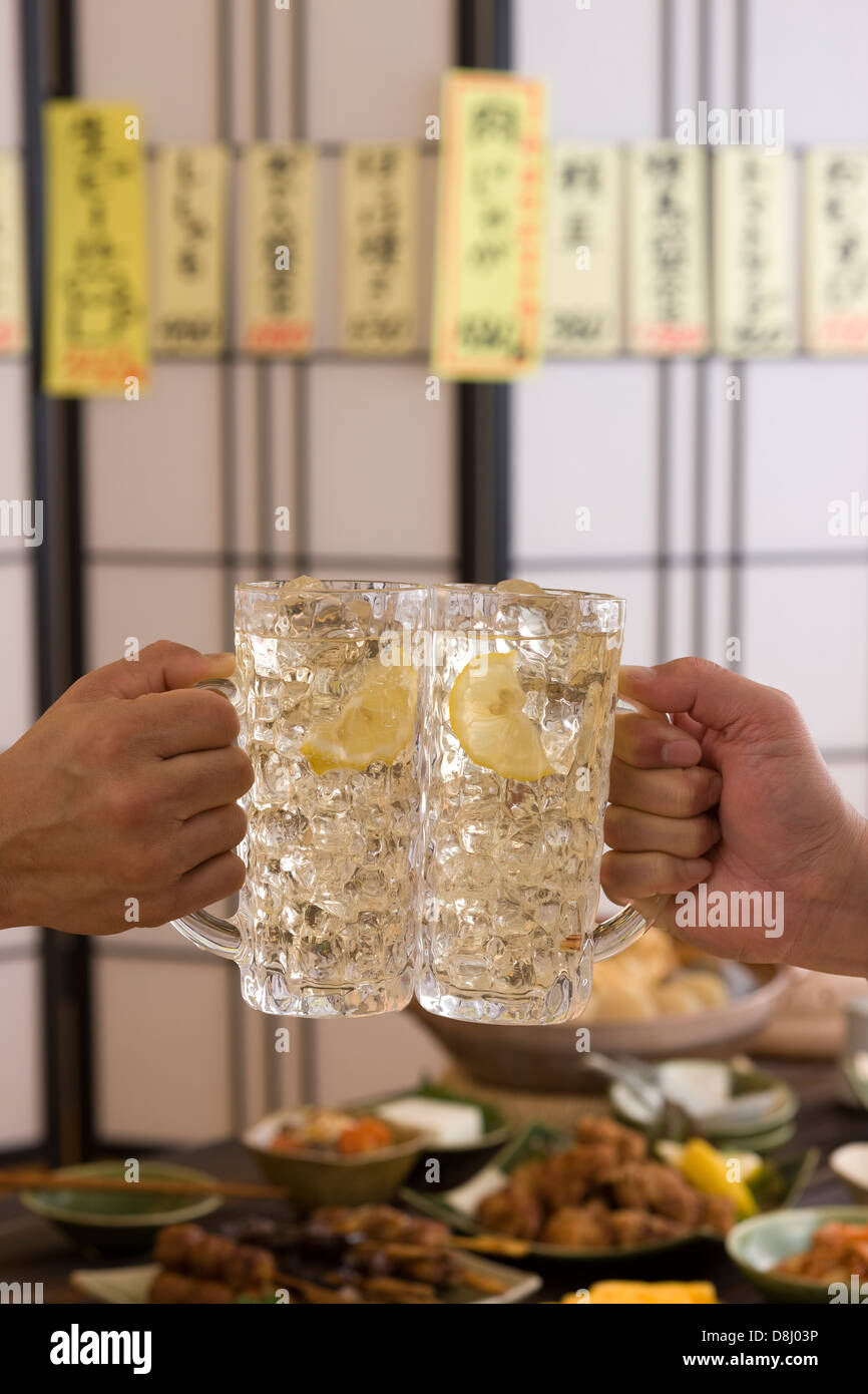 Two People Toasting with Whisky and Soda at Izakaya Stock Photo