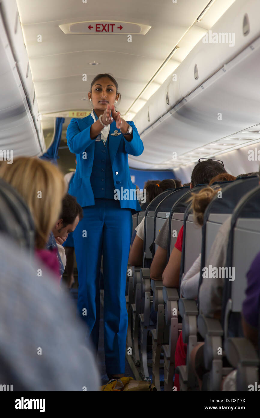 KLM air hostess gives safety instructions on board - Stock Image