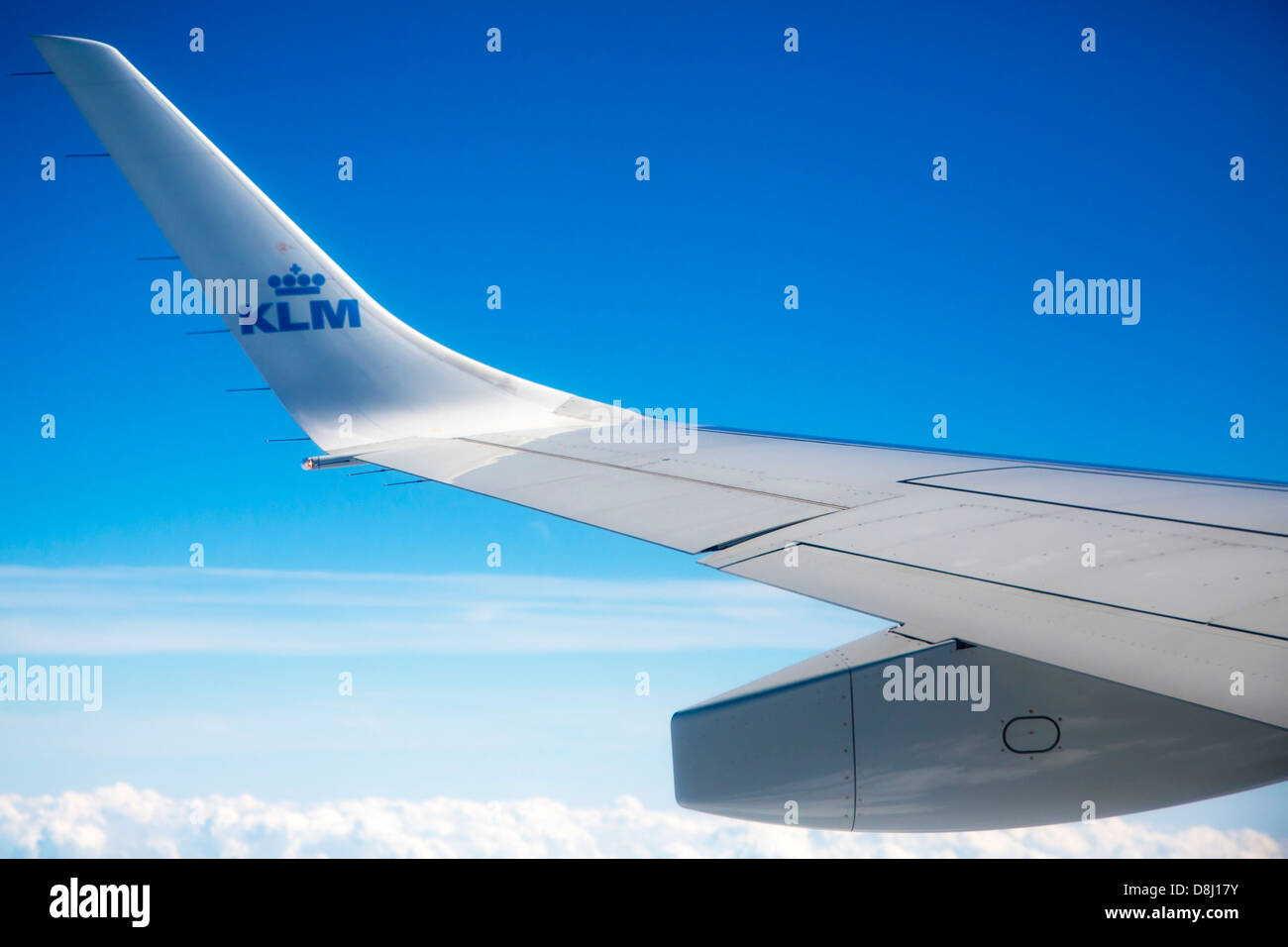 Window view from KLM jet flying over cloud Stock Photo