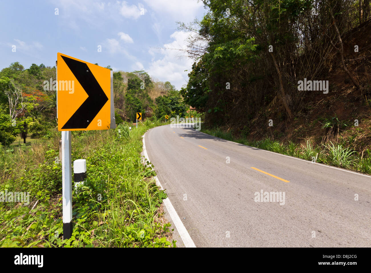 Road Signs warn Drivers about Ahead Dangerous Curve. - Stock Image