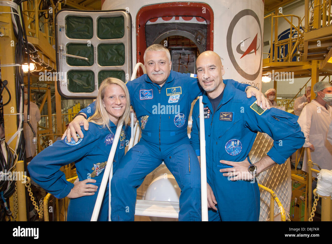 Expedition 36/37 Flight Engineer Karen Nyberg of NASA (left), Soyuz Commander Fyodor Yurchikhin (center) and Flight - Stock Image