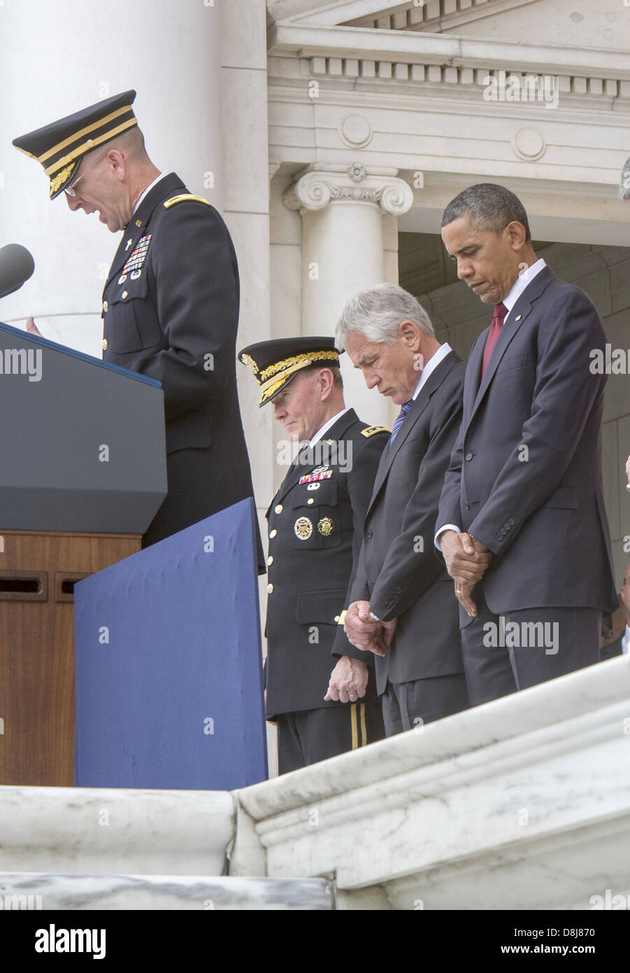 US President Barack Obama and Secretary of Defense Chuck Hagel stands for a moment of silence before the president - Stock Image