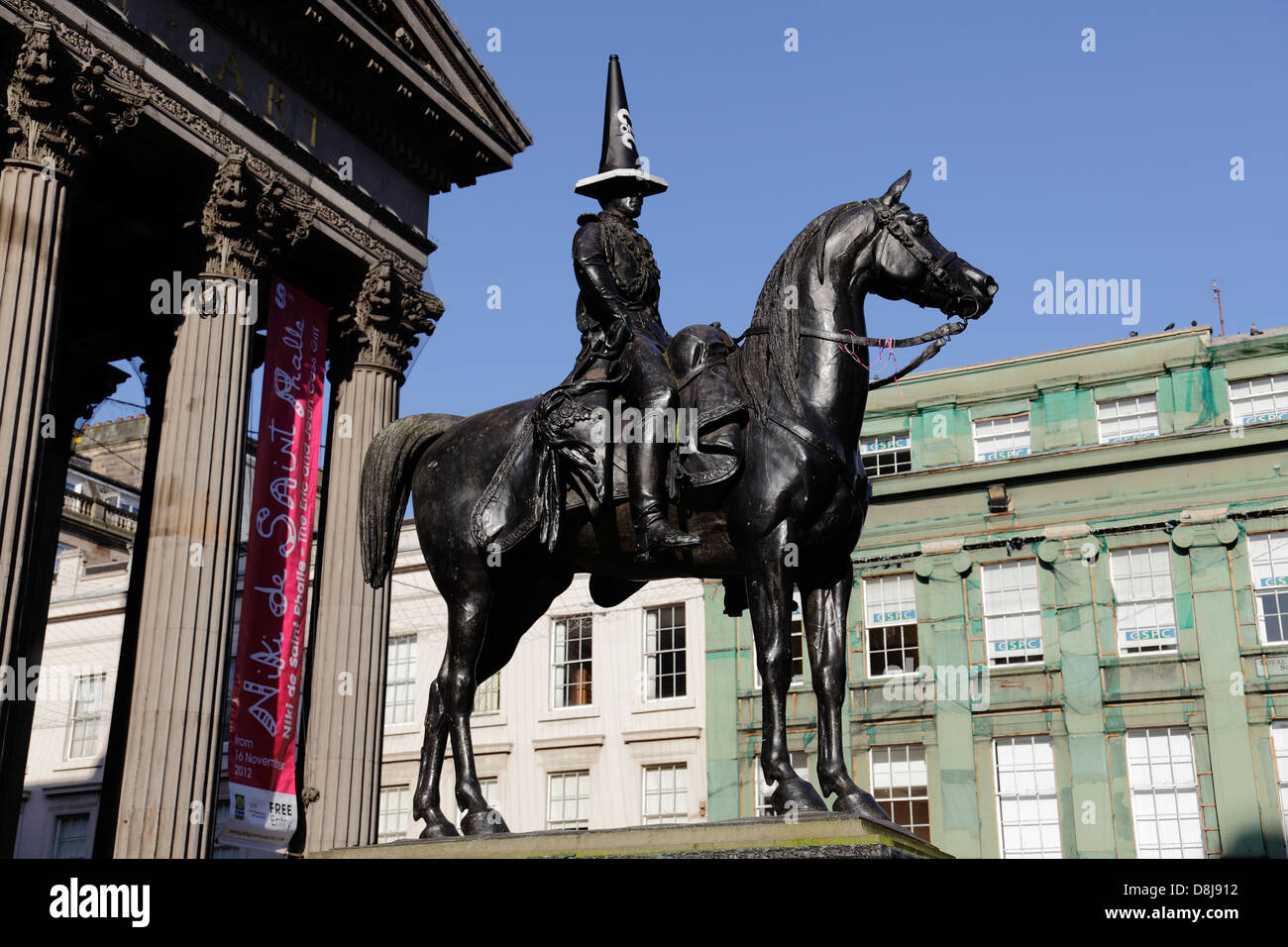 The Duke of Wellington statue with a black cone on it's head, Glasgow city centre, Scotland, UK - Stock Image