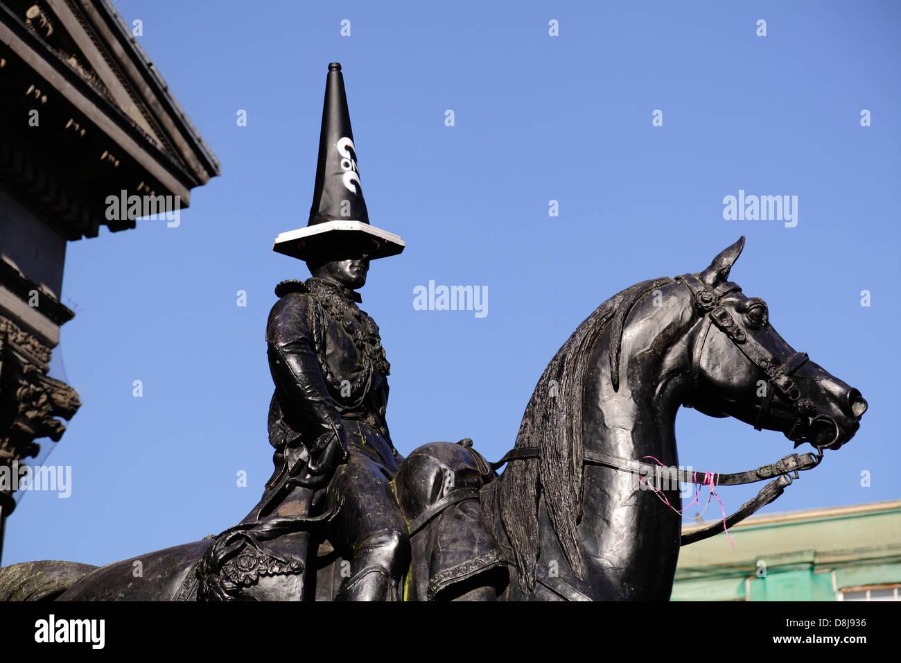 The Duke of Wellington statue with a cone, Glasgow, Scotland, UK - Stock Image
