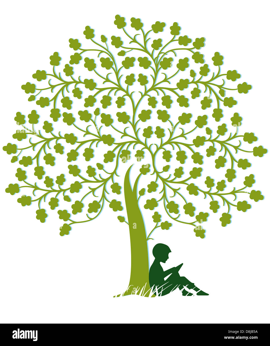 Child is reading under a tree Stock Photo