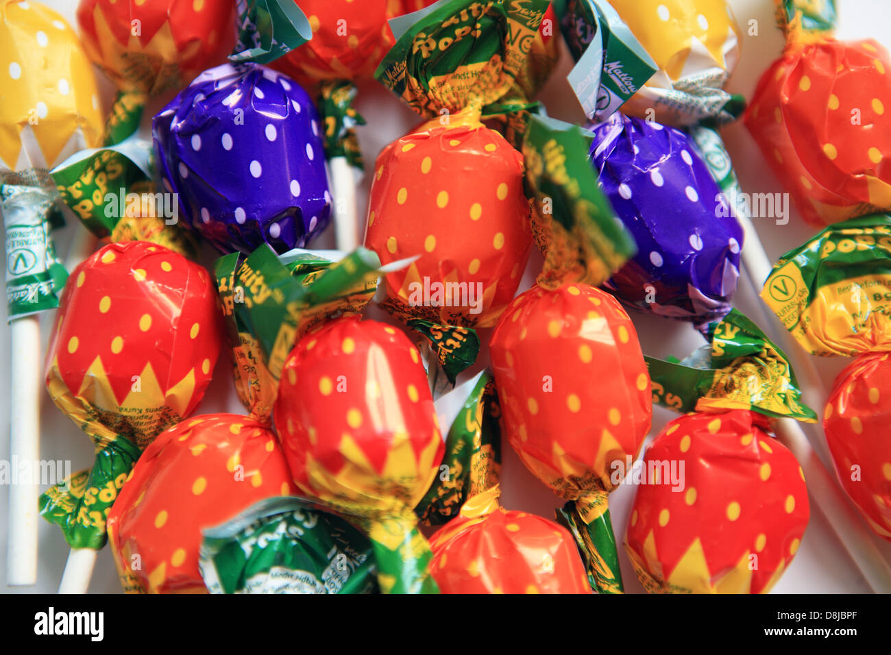 Lollipops with coloured wrappers - Stock Image