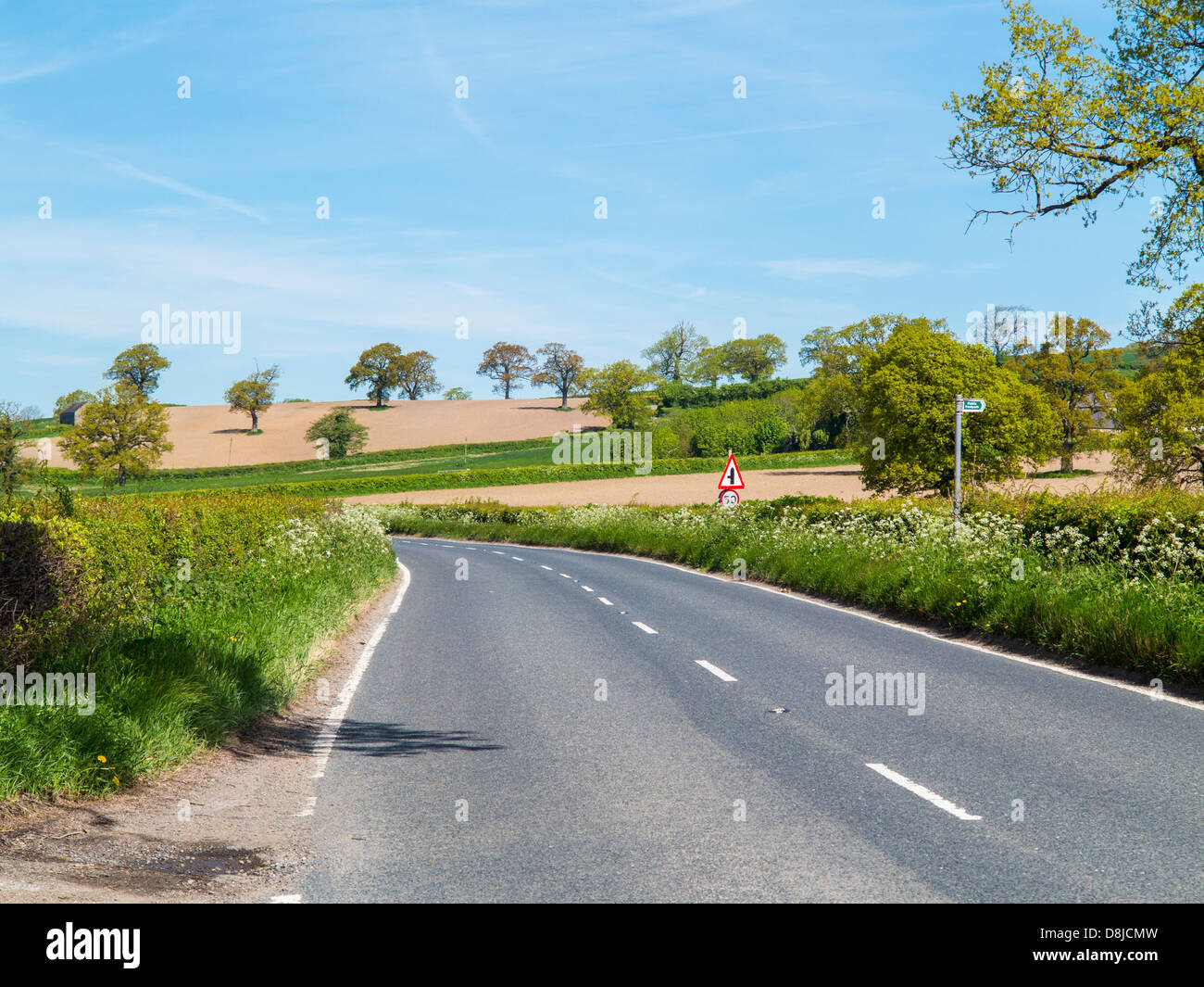 Winding country road through the Derbyshire countryside near Wirksworth, England. - Stock Image