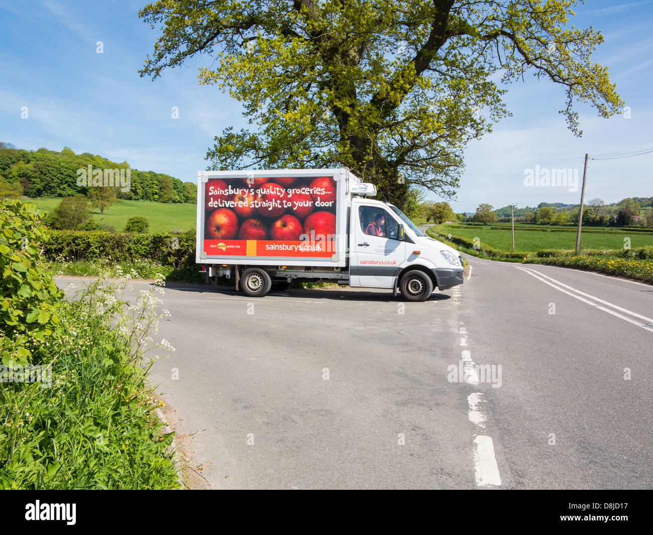 Sainsbury's delivery van in the rural setting of the Derbyshire dales near Wirksworth, England. - Stock Image