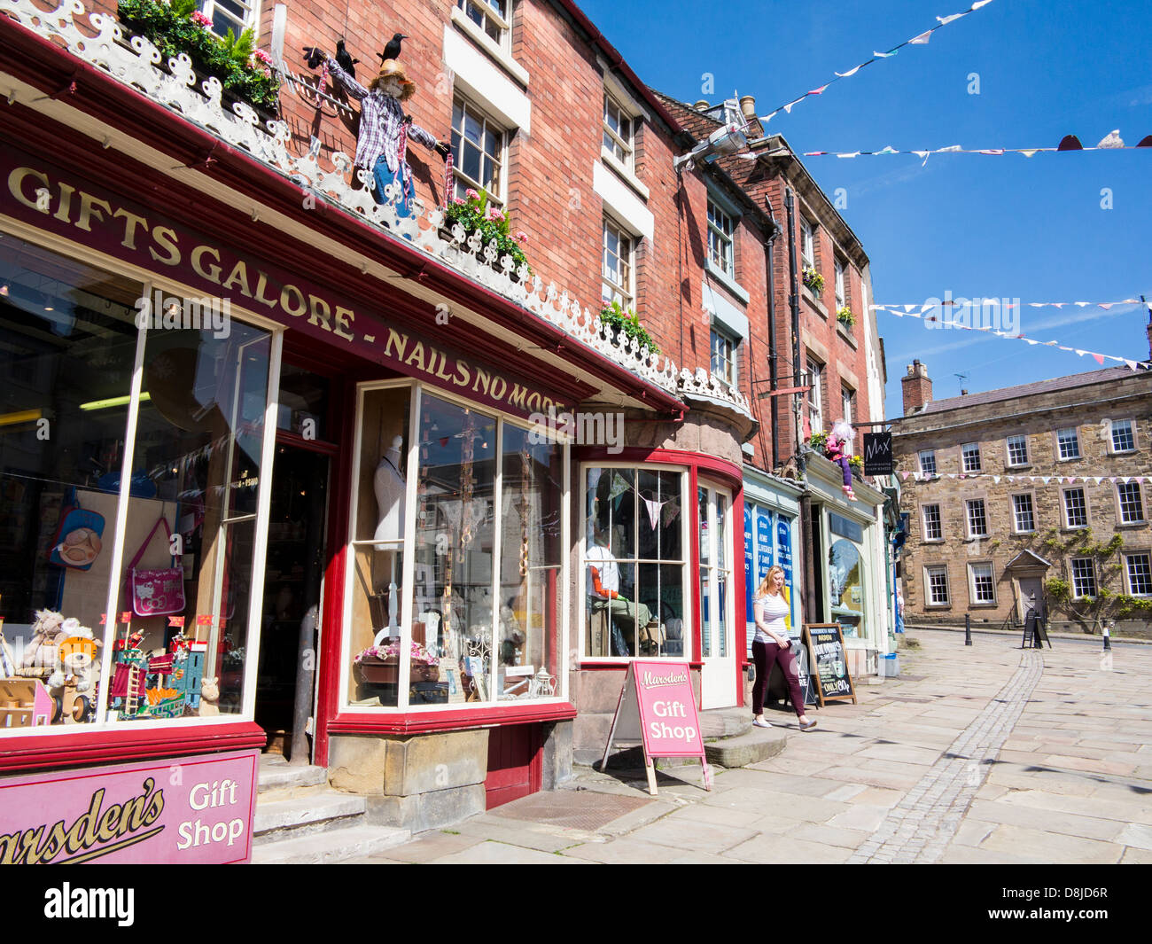 Wirksworth high street with Gifts Galore shop and bunting, Derbyshire, England. - Stock Image