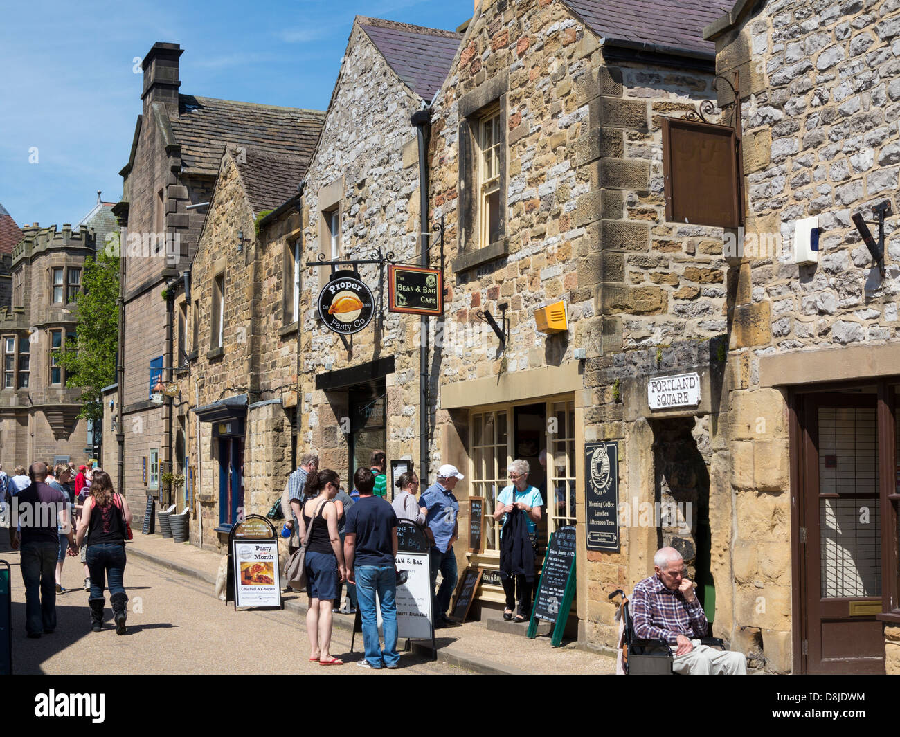 Bakewell High Street with shops and tourists, Derbyshire, England. - Stock Image