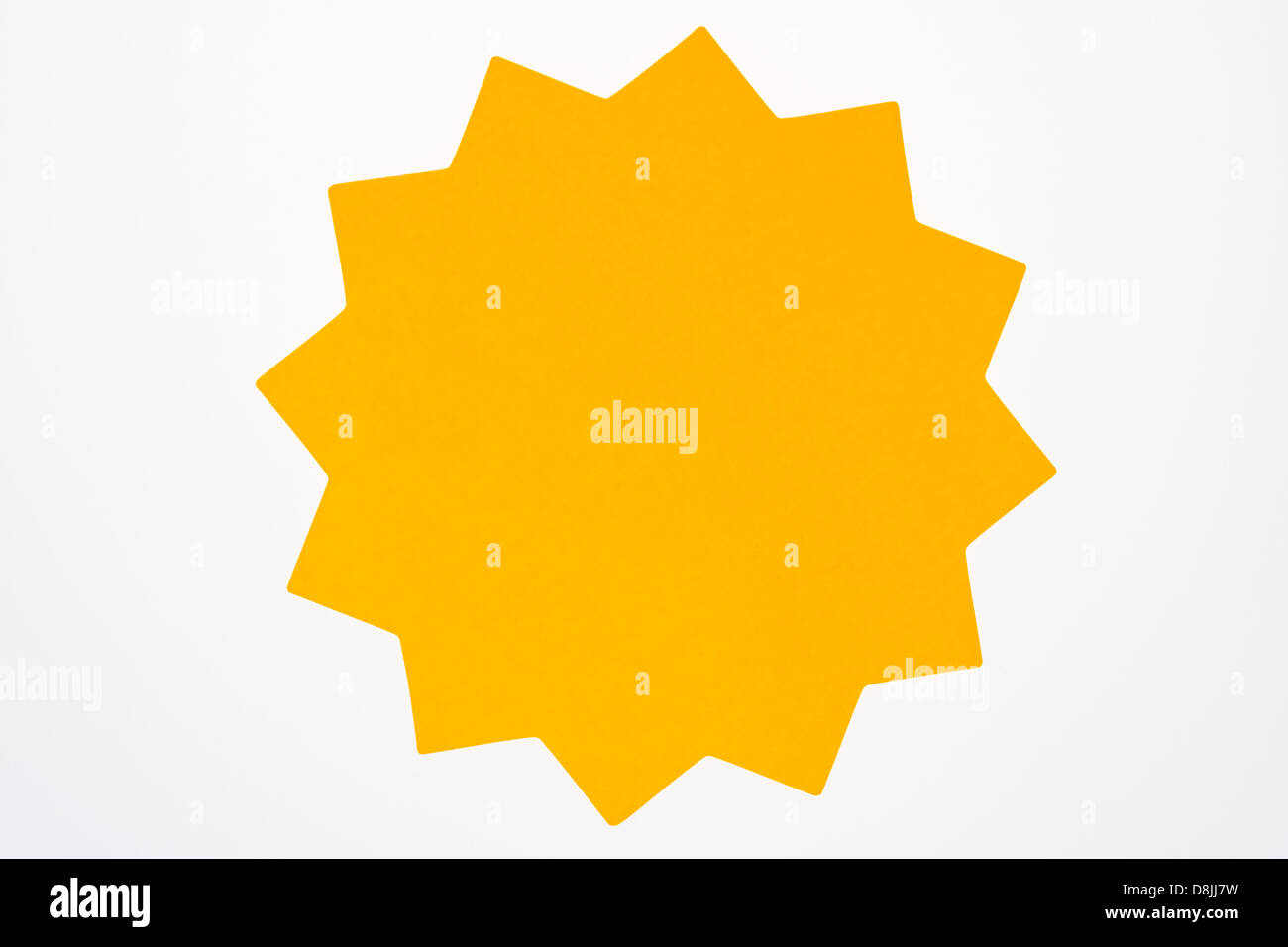A blank orange star shaped sign usually used to advertise sales and specials isolated on white. - Stock Image